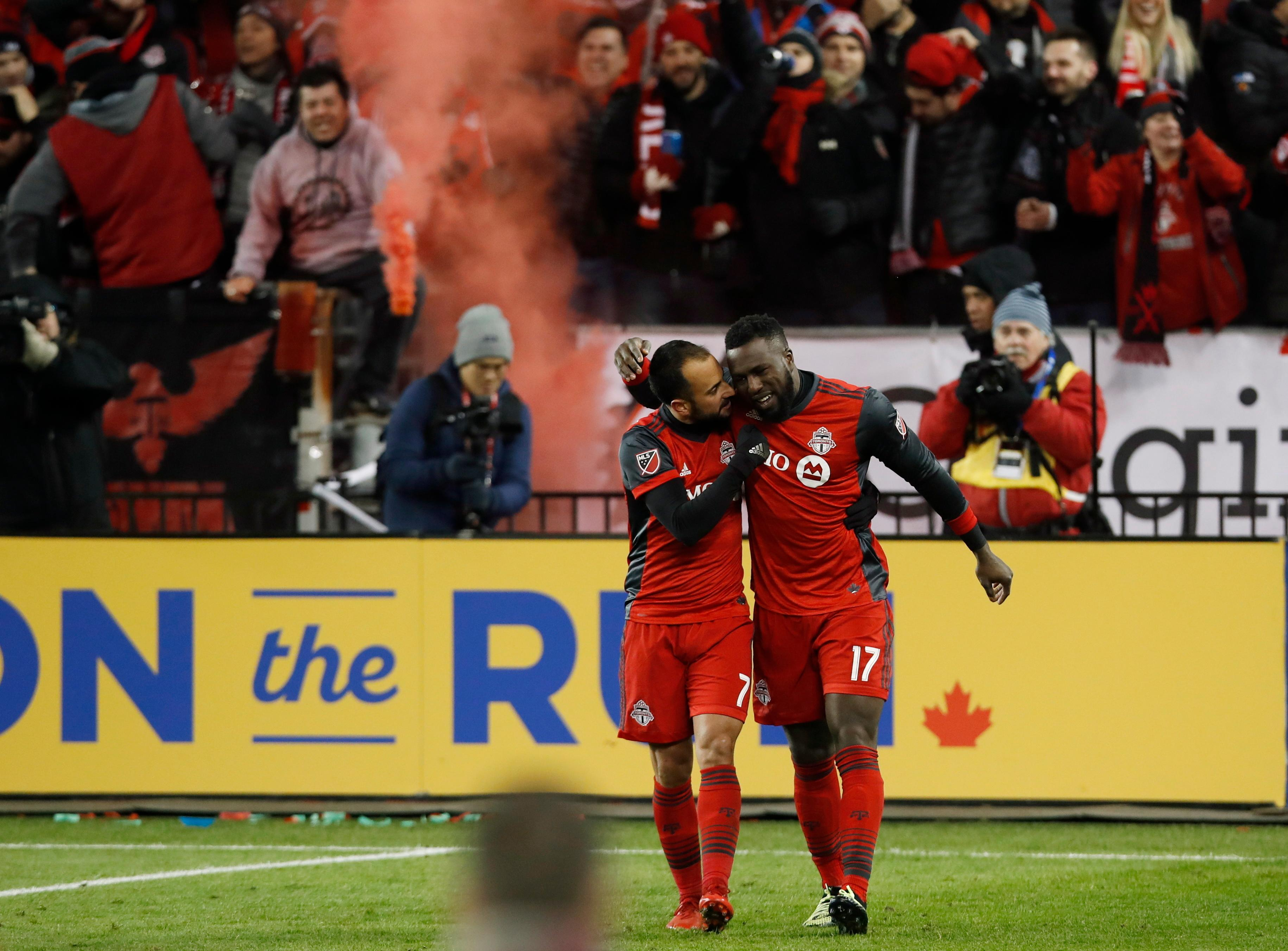 Toronto FC forward Jozy Altidore (17) celebrates his goal with midfielder Victor Vazquez (7) during the second half of an Eastern Conference MLS final playoff soccer game against the Columbus Crew, Wednesday, Nov. 29, 2017 in Toronto. (Mark Blinch/The Canadian Press via AP)