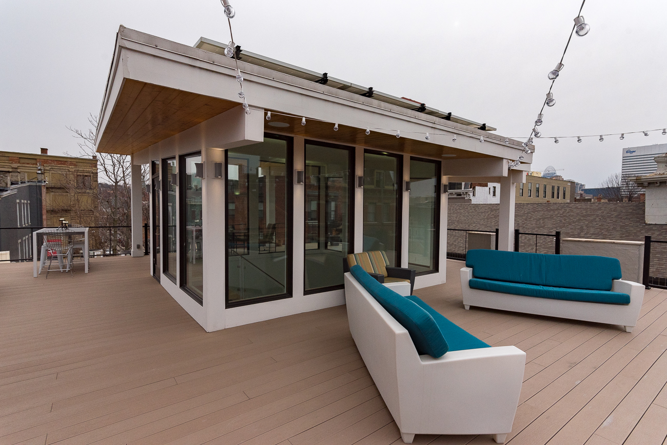The partially-covered rooftop deck wraps around the center where the atrium ends, and offers a 360-degree view of the area. / Image: Phil Armstrong, Cincinnati Refined // Published: 2.26.18