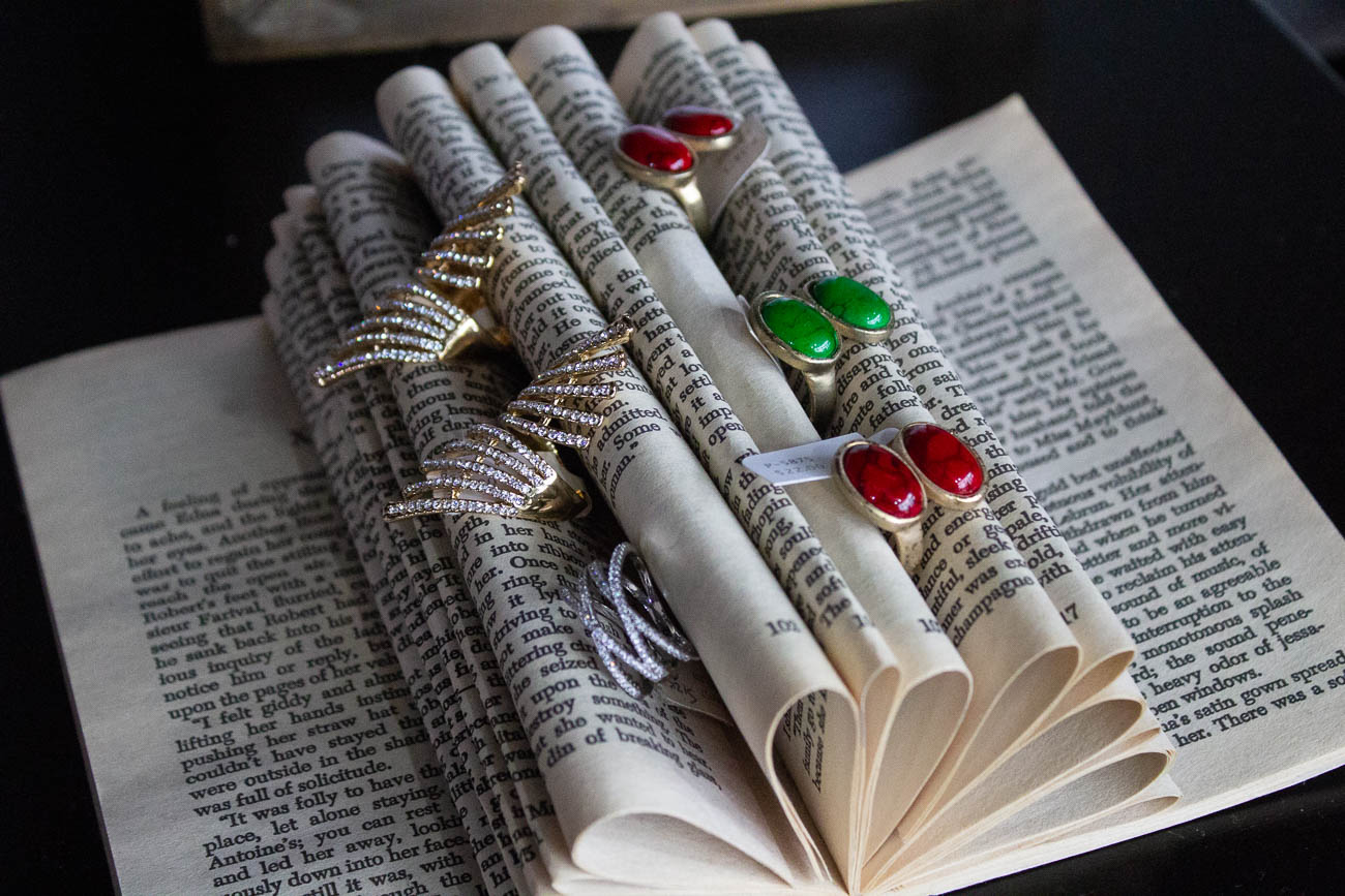 A book is used in a creative way to display jewelry. / Image: Katie Robinson, Cincinnati Refined // Published: 1.10.19