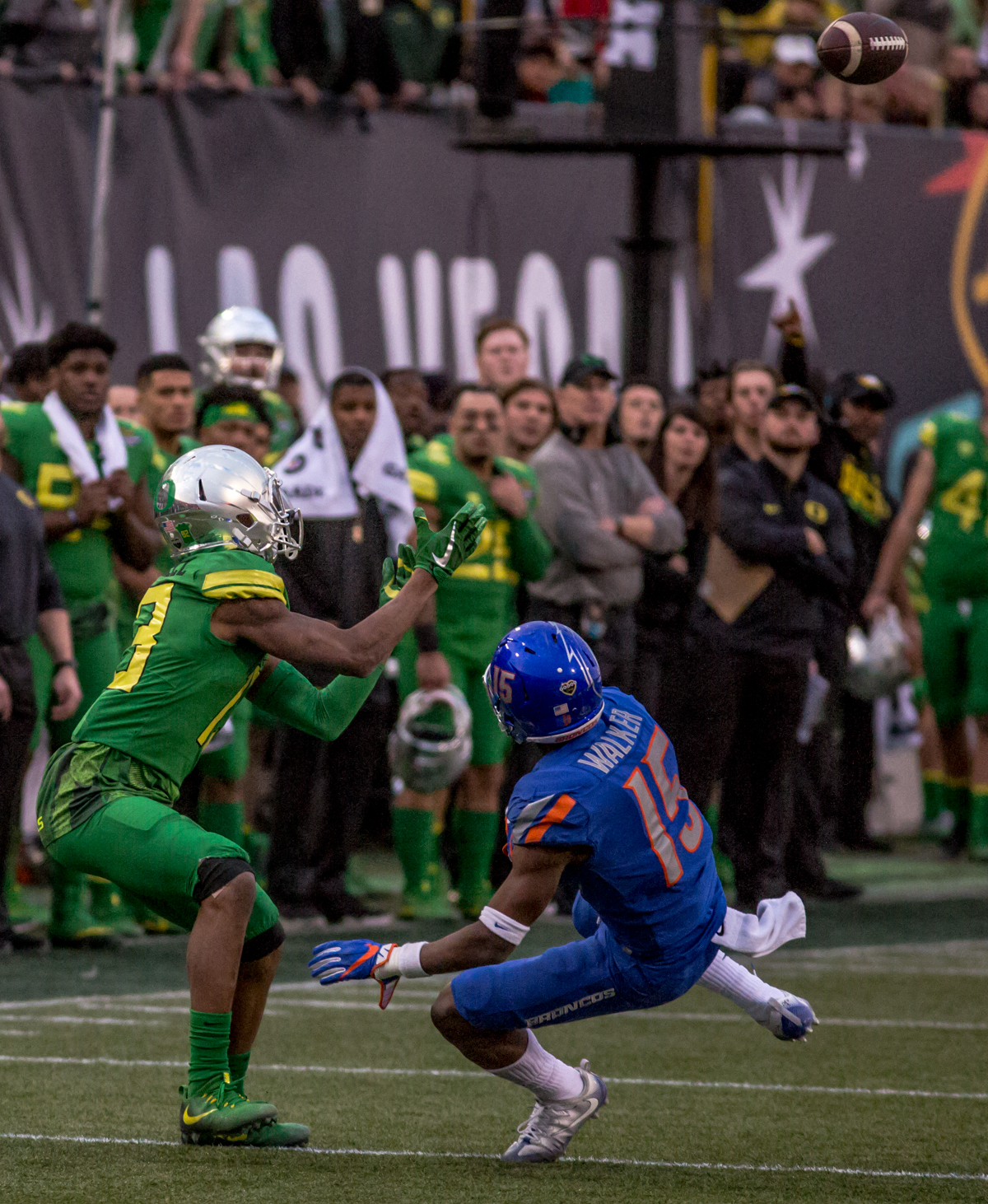 Oregon wide receiver Dillon Mitchell (#13) watches the ball. The Boise State Broncos defeated the Oregon Ducks 38 to 28 in the 2017 Las Vegas Bowl at Sam Boyd Stadium in Las Vegas, Nevada on Saturday December 17, 2017. The Las Vegas Bowl served as the first test for Oregon's new Head Coach Mario Cristobal following the loss of former Head Coach Willie Taggart to Florida State University earlier this month. Photo by Ben Lonergan, Oregon News Lab