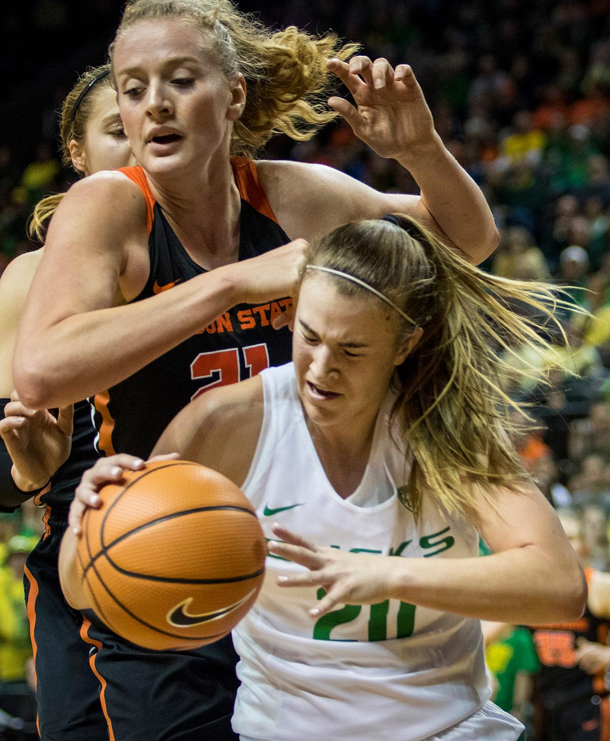 Oregon Ducks Sabrina Ionescu (#20) attempts to keep the ball away from Beaver defense. The Oregon Ducks defeated the Oregon State Beavers 75-63 on Sunday afternoon in front of a crowd of 7,249 at Matthew Knight Arena. The Ducks and Beavers split the two game Civil War with the Beavers defeating the Ducks on Friday night in Corvallis. The Ducks had four players in double digits: Satou Sabally with 21 points, Maite Cazorla with 16, Sabrina Ionescu with 15, and Mallory McGwire with 14. The Ducks shot 48.4% from the floor compared to the Beavers 37.3%. The Ducks are now 7-1 in conference play. Photo by Rhianna Gelhart, Oregon News Lab