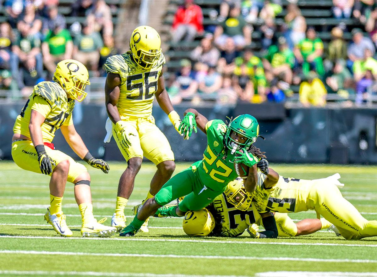 The Thunder's Darrian Felix (#22) is brought down by the Lightning. The Thunder defeated the Lightning 59-24 in the Spring Game on Saturday at Autzen Stadium. Photo by August Frank