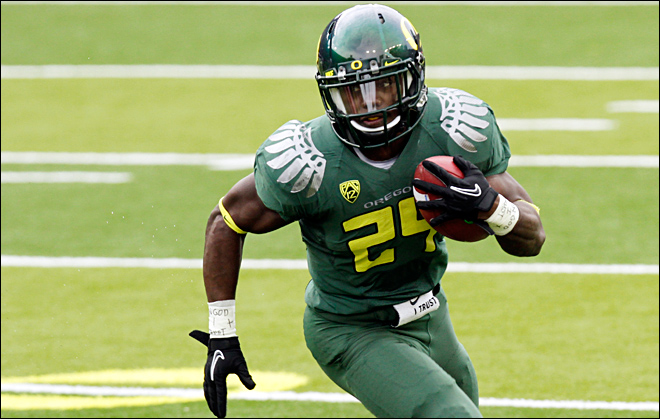 Kenjon Barner played for the Oregon Ducks from 2009-12 under head coach Chip Kelly.