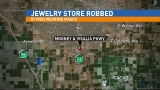 Visalia jewelry store robbed by men in masks
