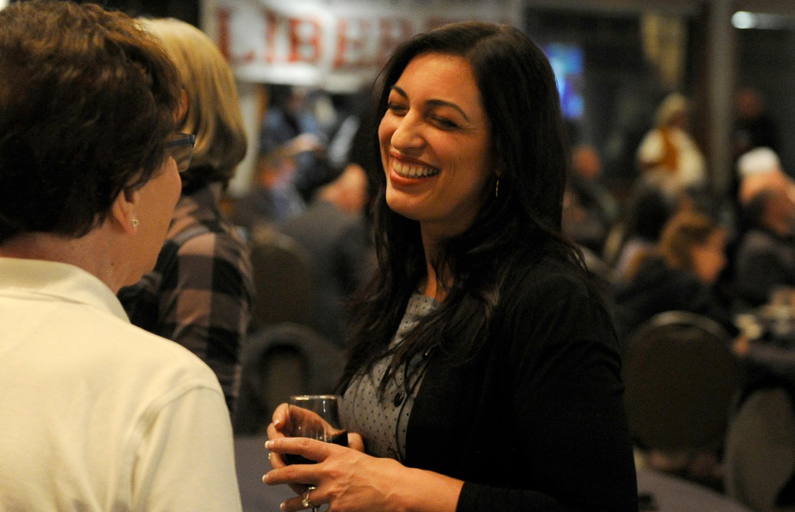 Andy Atkinson / Mail Tribune{ } Jessica Gomez talks with supporters and the Republican party at the Rogue Valley Country Club Tuesday evening.