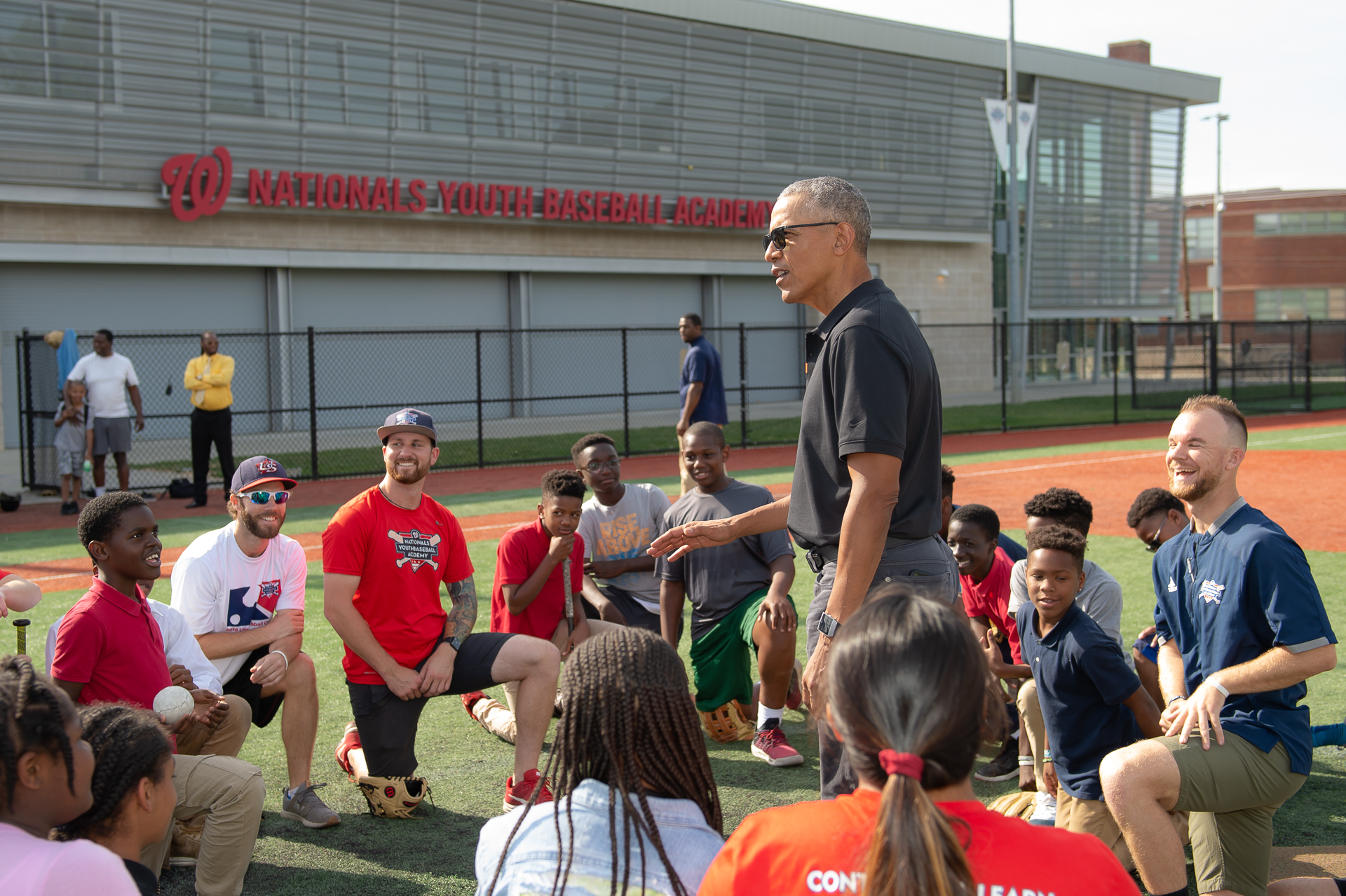 Former U.S. President Barack Obama speaks to students and coaches during his visit to the Washington Nationals Youth Baseball Academy in D.C. (Image: Paul Kim/ Washington Nationals Youth Baseball Academy)