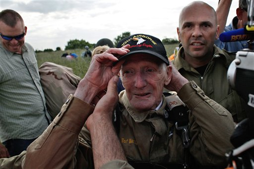 93-year-old U.S. WWII veteran Jim Martin of the 101st Airborne adjusts his cap after he performed a tandem parachute jump on to Utah Beach, western France as part of the commemoration of the 70th anniversary of the D Day.