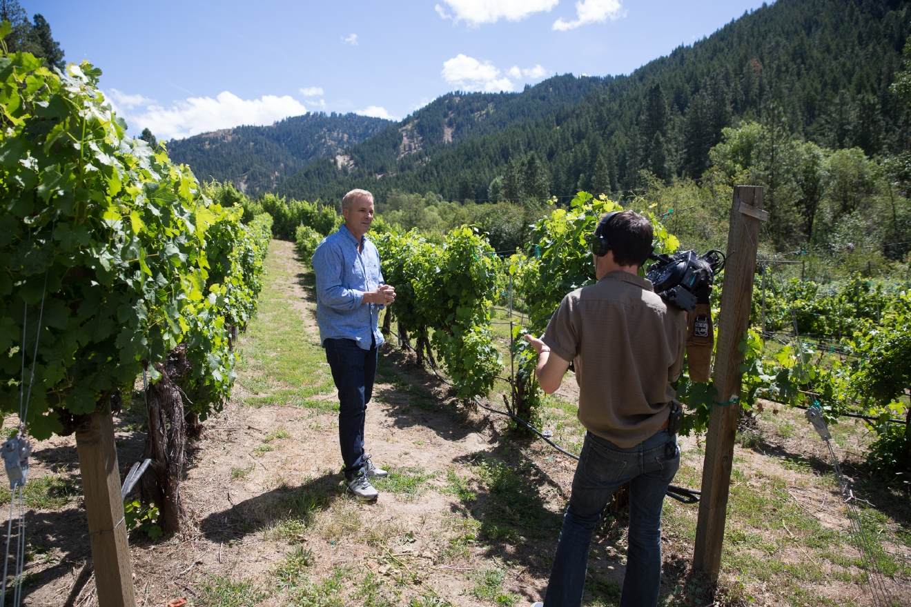 "On a recent trip to Lake Chelan, we were tasked with exploring multiple wineries, restaurants, activity centers and views to put into a half-hour TV show. Tough life right? Well actually, it really is - because we could go on and on about the things we saw for much longer than 30 minutes. Soooo we are going to do a quick Chelan Spotlight every week to highlight some of the places we saw! This week, it's all about Eagle Creek Winery. ""Whispering pines, mature vines, world-class wines."" Can it get any better? Doesn't hurt that we visited on a BEAUTIFUL day, and the already gorgeous winery looks its very best. Edward & Patricia Rutledge call this winery, tasting room and cottage at the foothills of the Cascade Mountains home, and Ed personally selects grapes from the vineyard for their world-class wines. (Image: Joshua Lewis / Seattle Refined)"