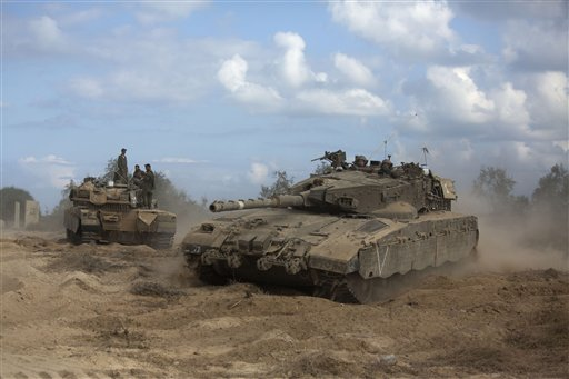 An Israeli tank moves into position near the Israel and Gaza border, Friday.