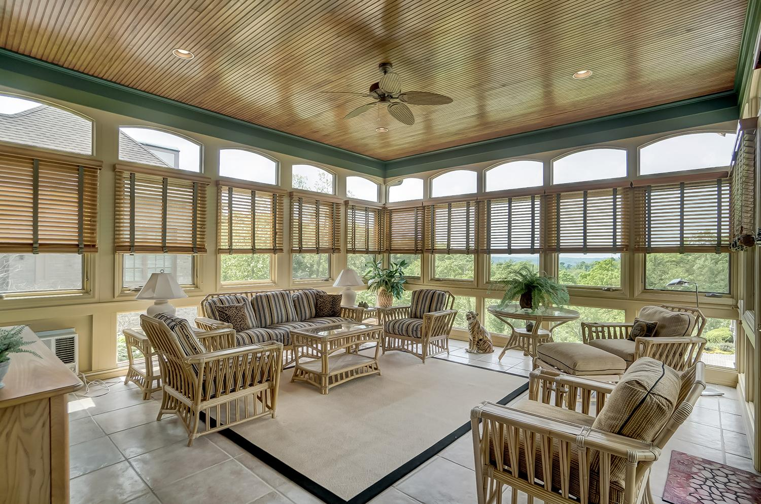 Designed for year-round living, the four-season room is filled with natural light and makes a great gathering spot for the whole family. / Image: Wow Video Tours // Published: 6.8.18