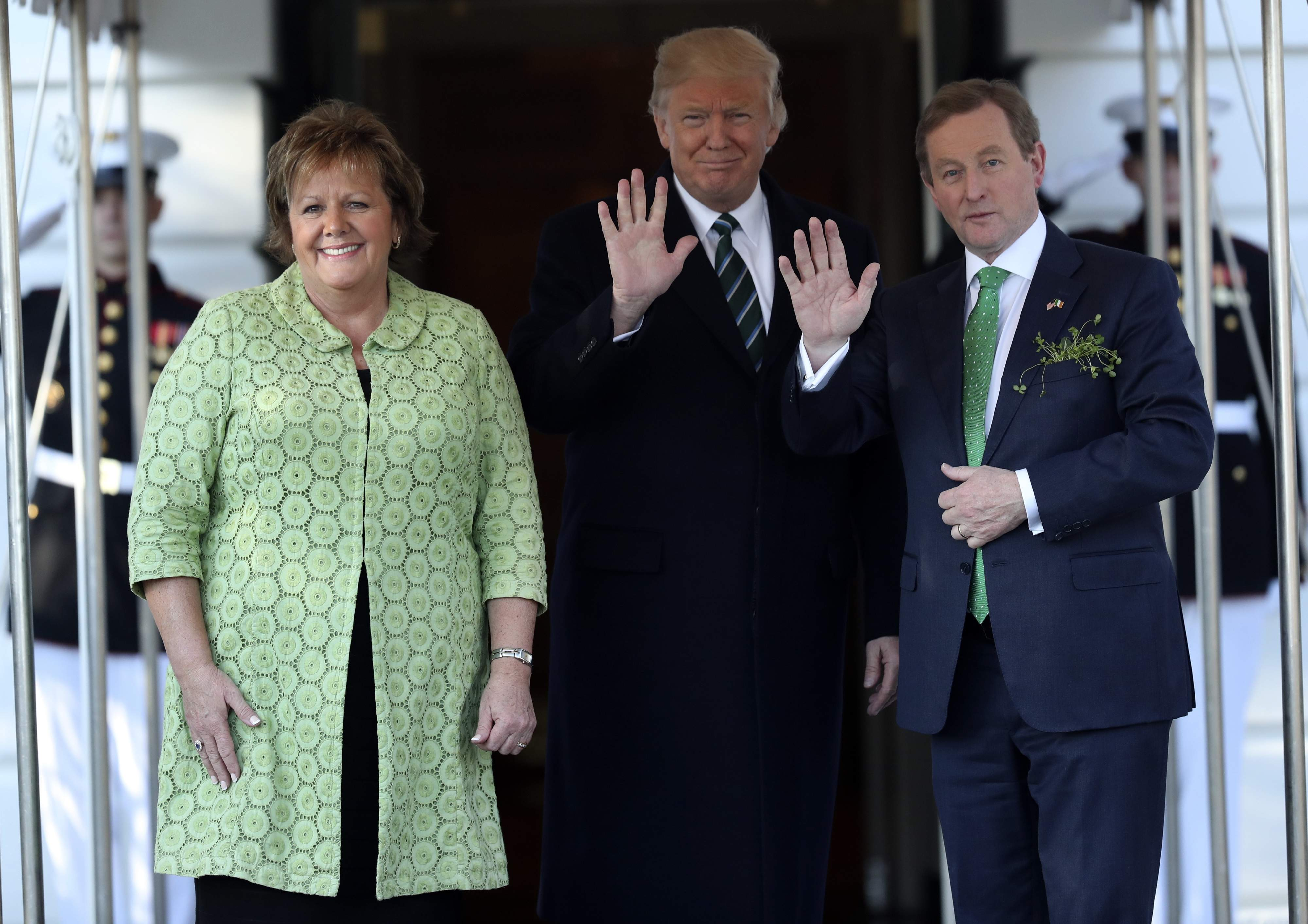 DAY 56 - In this March 16, 2017, file photo, President Donald Trump waves as he greets Irish Prime Minister Enda Kenny and his wife Fionnuala Kenny, left, on the South Lawn of the White House in Washington. (AP Photo/Andrew Harnik, File)