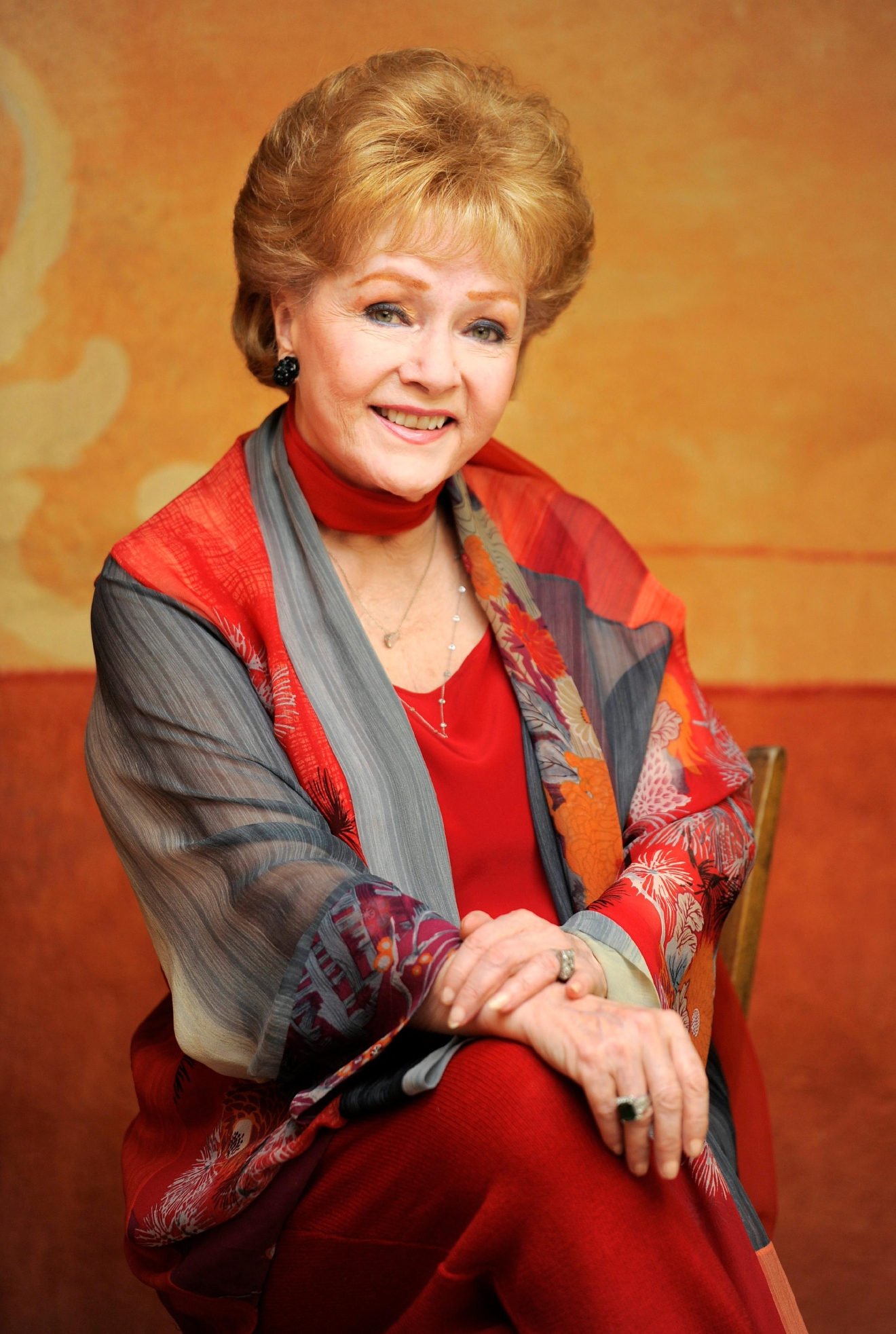 "FILE - In this May 21, 2013 file photo, actress Debbie Reynolds poses for a portrait in Beverly Hills, Calif. Reynolds, star of the 1952 classic ""Singin' in the Rain"" died Wednesday, Dec. 28, 2016, according to her son Todd Fisher. She was 84. (Photo by Chris Pizzello/Invision/AP, File)"