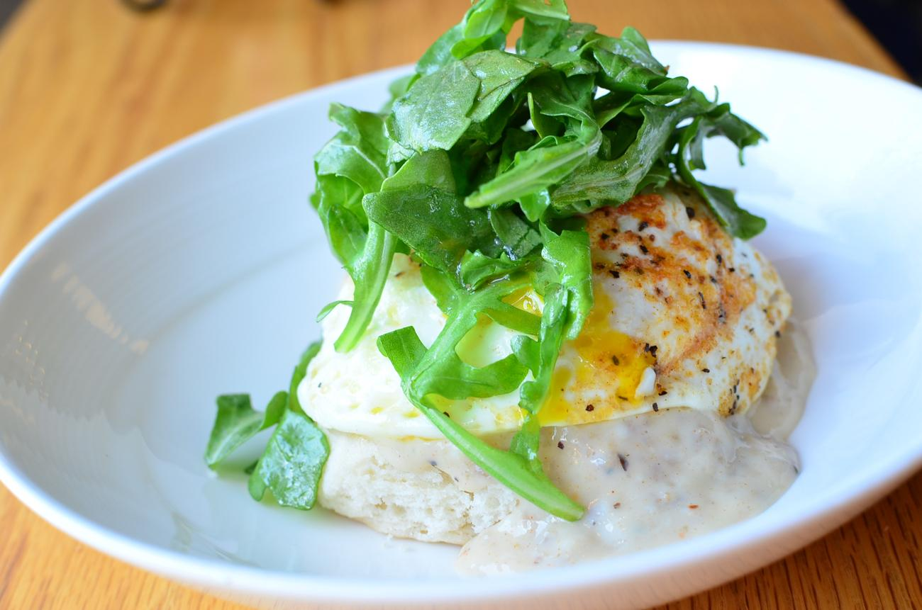 Biscuit and gravy with an over-easy egg and topped with arugula / Image: Leah Zipperstein, Cincinnati Refined // Published: 9.6.17