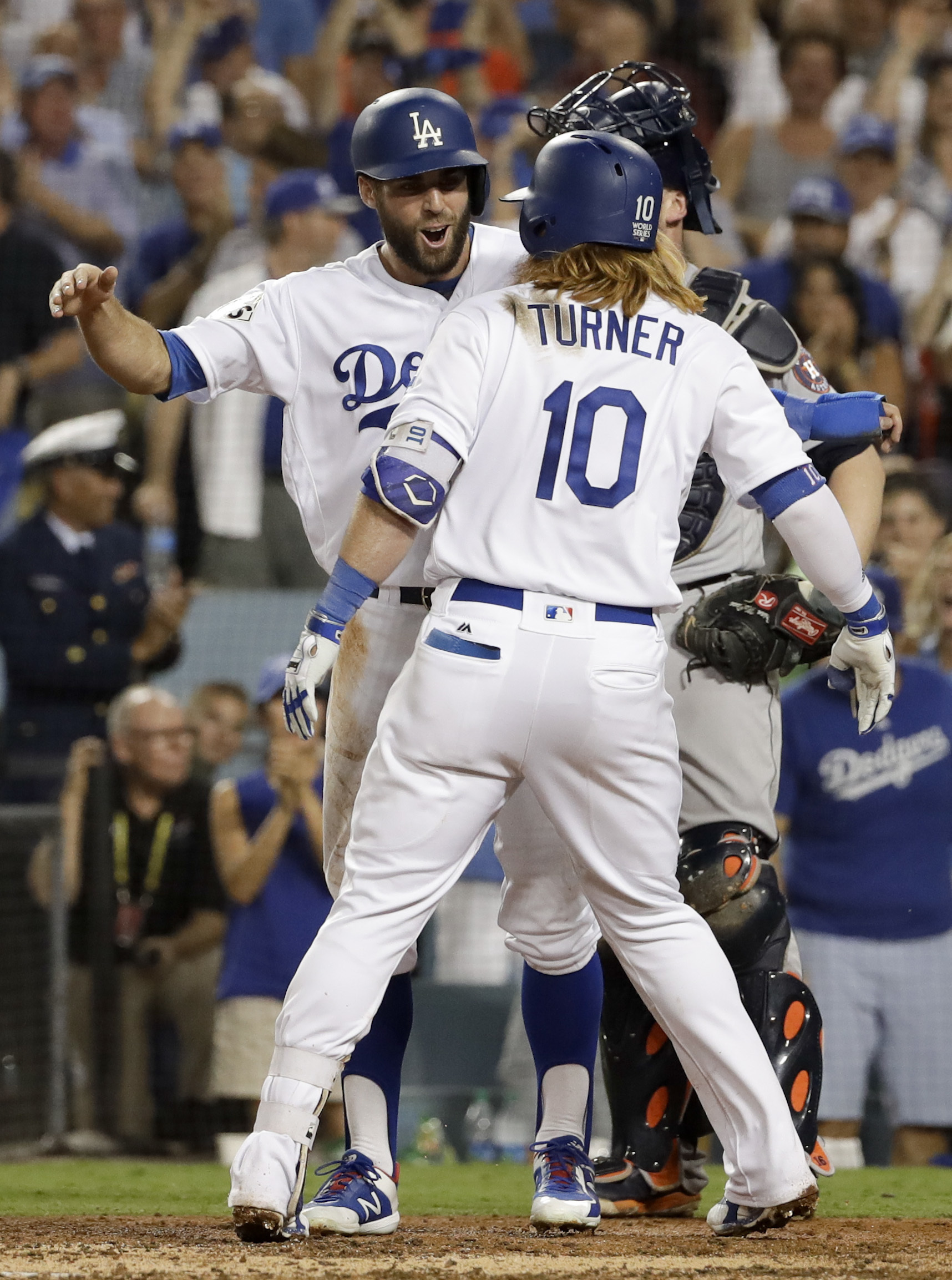 Los Angeles Dodgers' Justin Turner, right, celebrates his two-run home run with Chris Taylor against the Houston Astros during the sixth inning of Game 1 of baseball's World Series Tuesday, Oct. 24, 2017, in Los Angeles.(AP Photo/Matt Slocum)