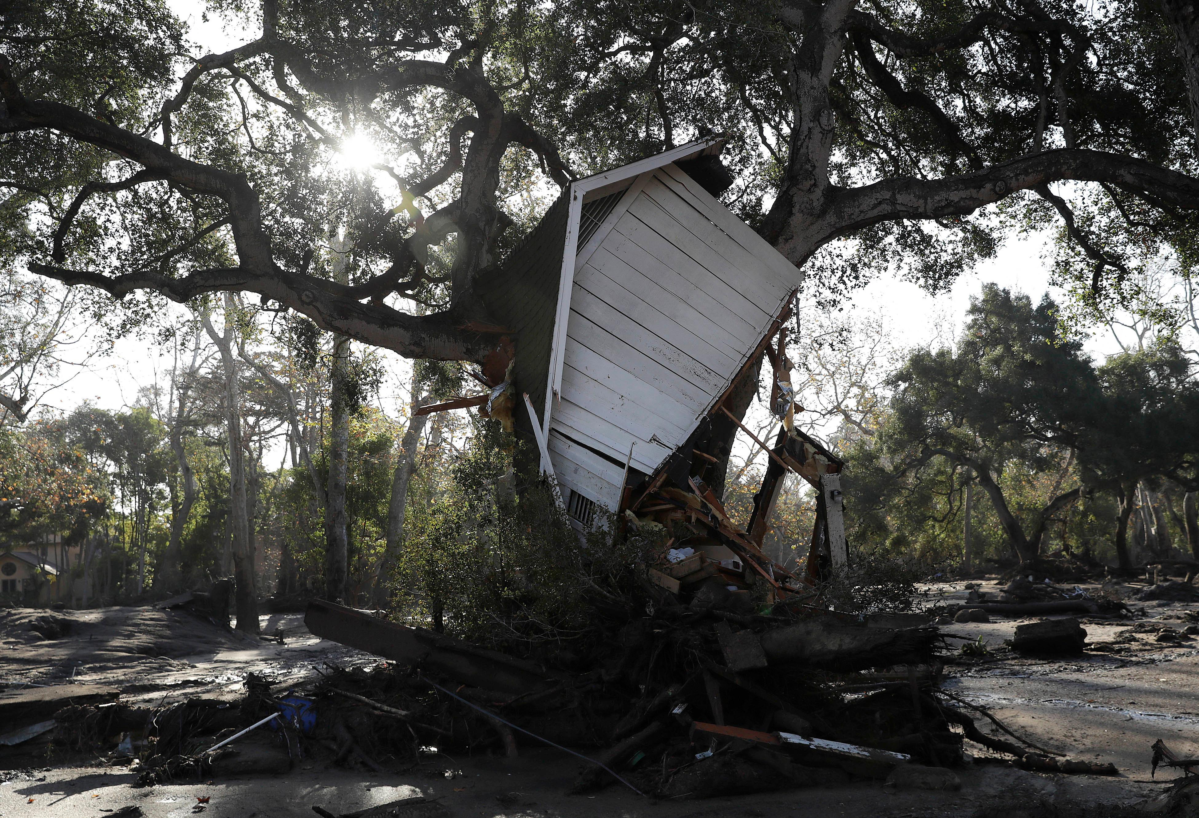 A structure damaged from storms is shown in Montecito, Calif., Thursday, Jan. 11, 2018.  Hundreds of rescue workers slogged through knee-deep ooze and used long poles to probe for bodies Thursday as the search dragged on for victims of the mudslides that slammed this wealthy coastal town. (AP Photo/Marcio Jose Sanchez)
