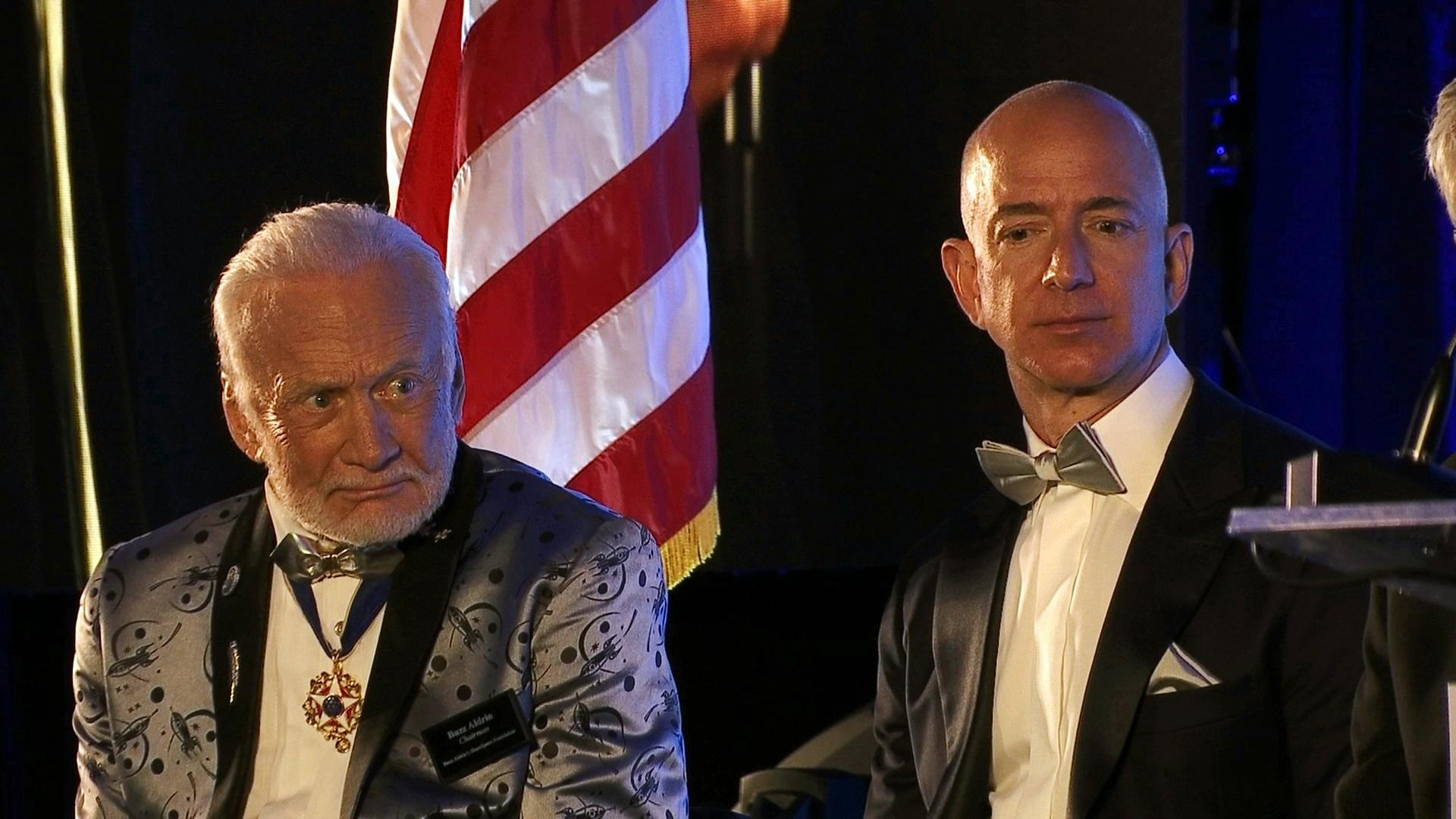 Apollo 11 astronaut Buzz Aldrin, left, and Amazon.com and Blue Origins founder Jeff Bezos attend the commemoration for the upcoming anniversary of the 1969 mission to the moon and a gala for Aldrin's non-profit space education foundation, ShareSpace Foundation, at the Kennedy Space Center in Cape Canaveral, Fla., on Saturday, July 15, 2017. (AP Photo/Alex Sanz)