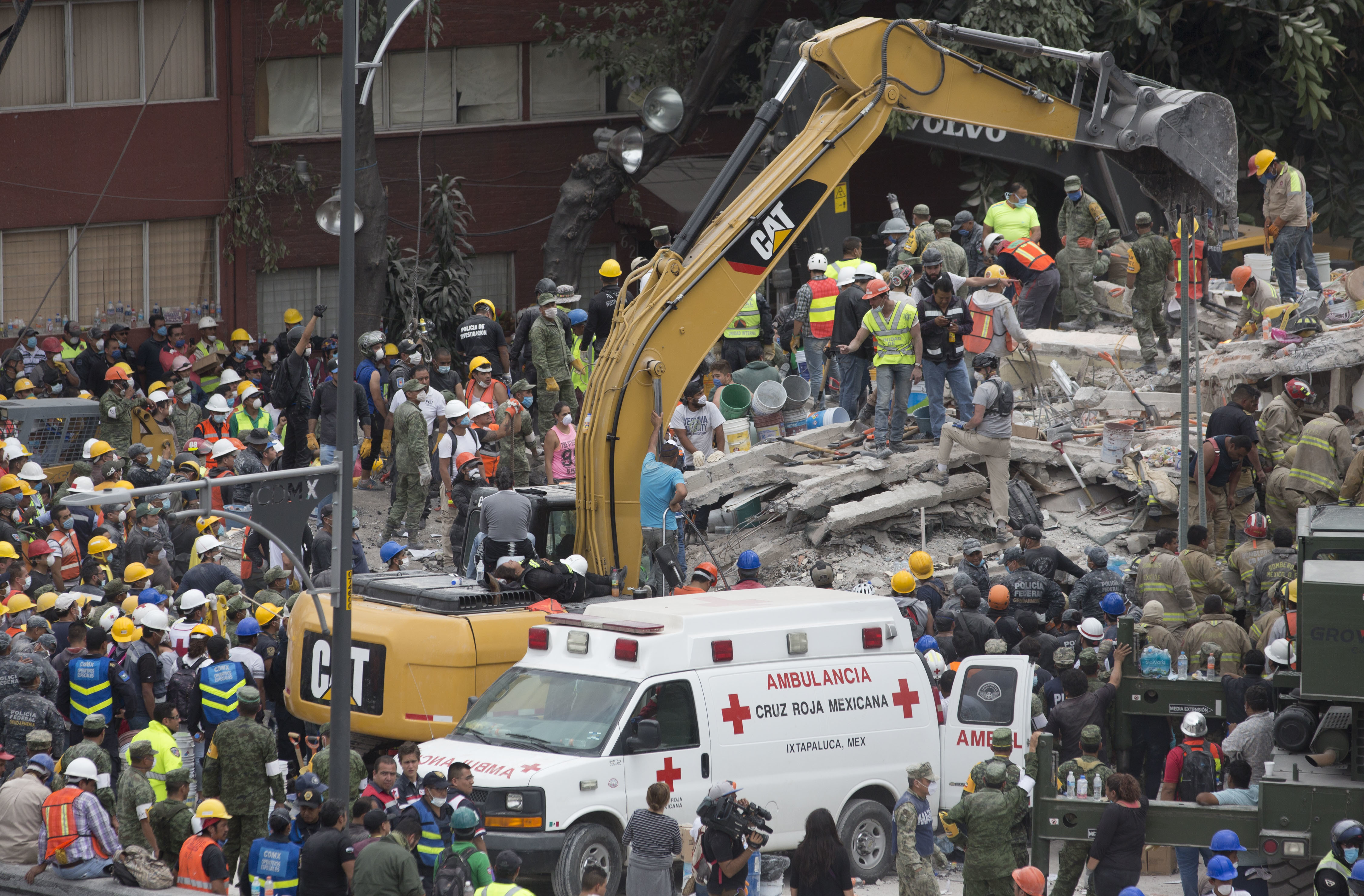 Rescue personnel work on a collapsed building, a day after a devastating 7.1 earthquake, in the Del Valle neighborhood of Mexico City, Wednesday, Sept. 20, 2107. Efforts continue at the scenes of dozens of collapsed buildings, where firefighters, police, soldiers and civilians continue their search to reach the living. (AP Photo/Moises Castillo)