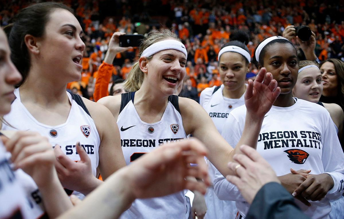 Oregon State's Sydney Wiese, center, celebrates with teammates after Oregon State defeated Creighton 64-52 in a second-round game in the NCAA women's college basketball tournament Sunday, March 19, 2017, in Corvallis, Ore. (AP Photo/Timothy J. Gonzalez)