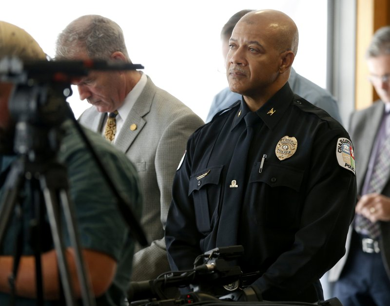 <p>Charlottesville Police Chief Al S. Thomas Jr. listens to Attorney Timothy Heaphy as he delivers an independent report on the issues concerning the white supremacist rally and protest in Charlottesville, during a news conference in Charlottesville, Va., Friday, Dec. 1, 2017. (AP Photo/Steve Helber)</p>