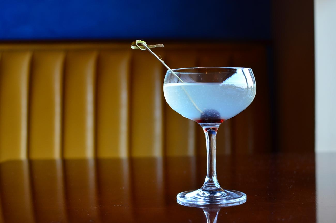 "A beautiful blue cocktail against a mustard yellow leather booth at Embers Restaurant. First published on January 27 in ""Half-Price Sushi Night At Embers Is The Place To Be"" / Image: Leah Zipperstein"