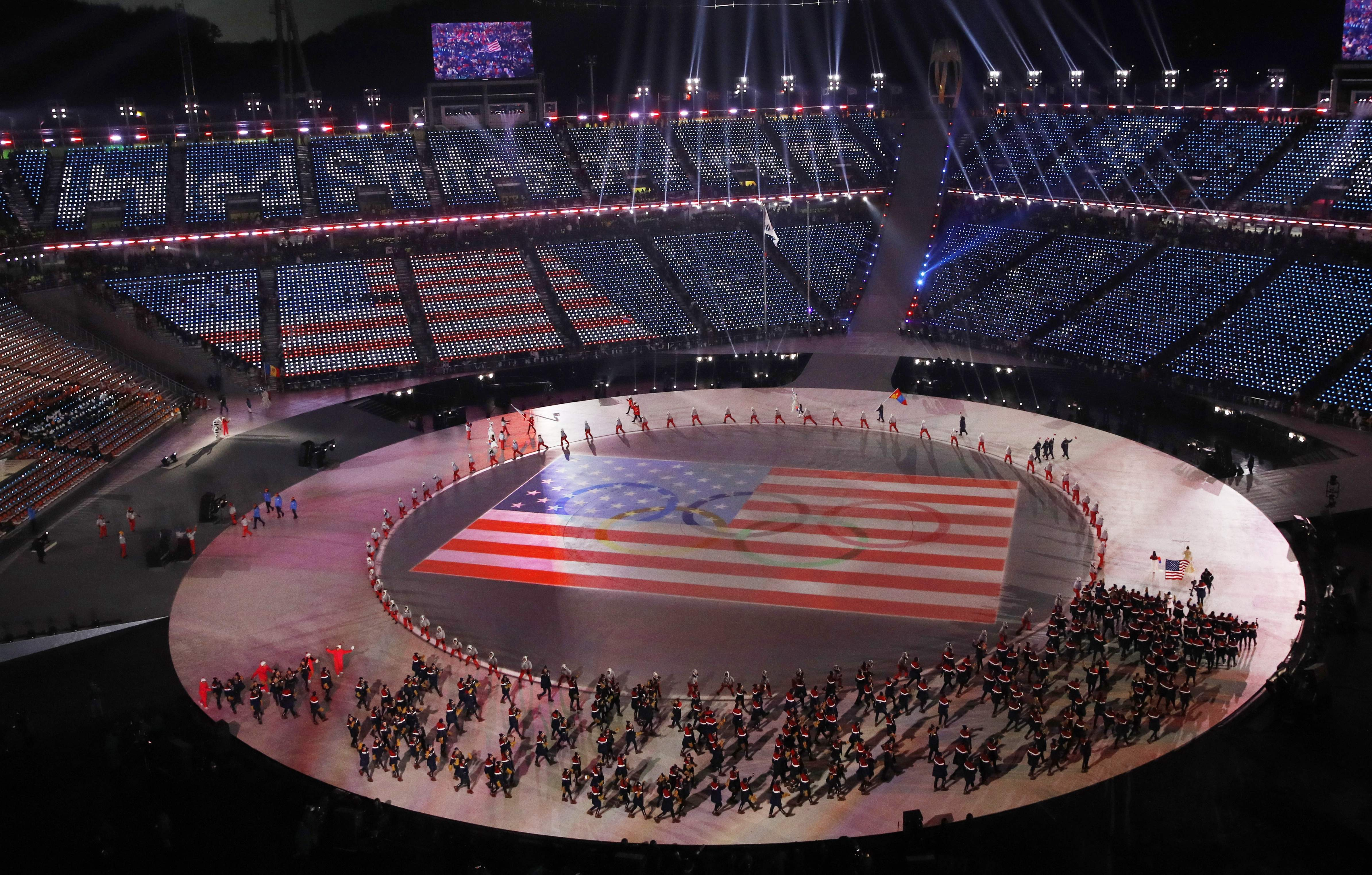 The team from the United States walk onto the stage during the opening ceremony of the 2018 Winter Olympics in Pyeongchang, South Korea, Friday, Feb. 9, 2018. (AP Photo/Charlie Riedel)