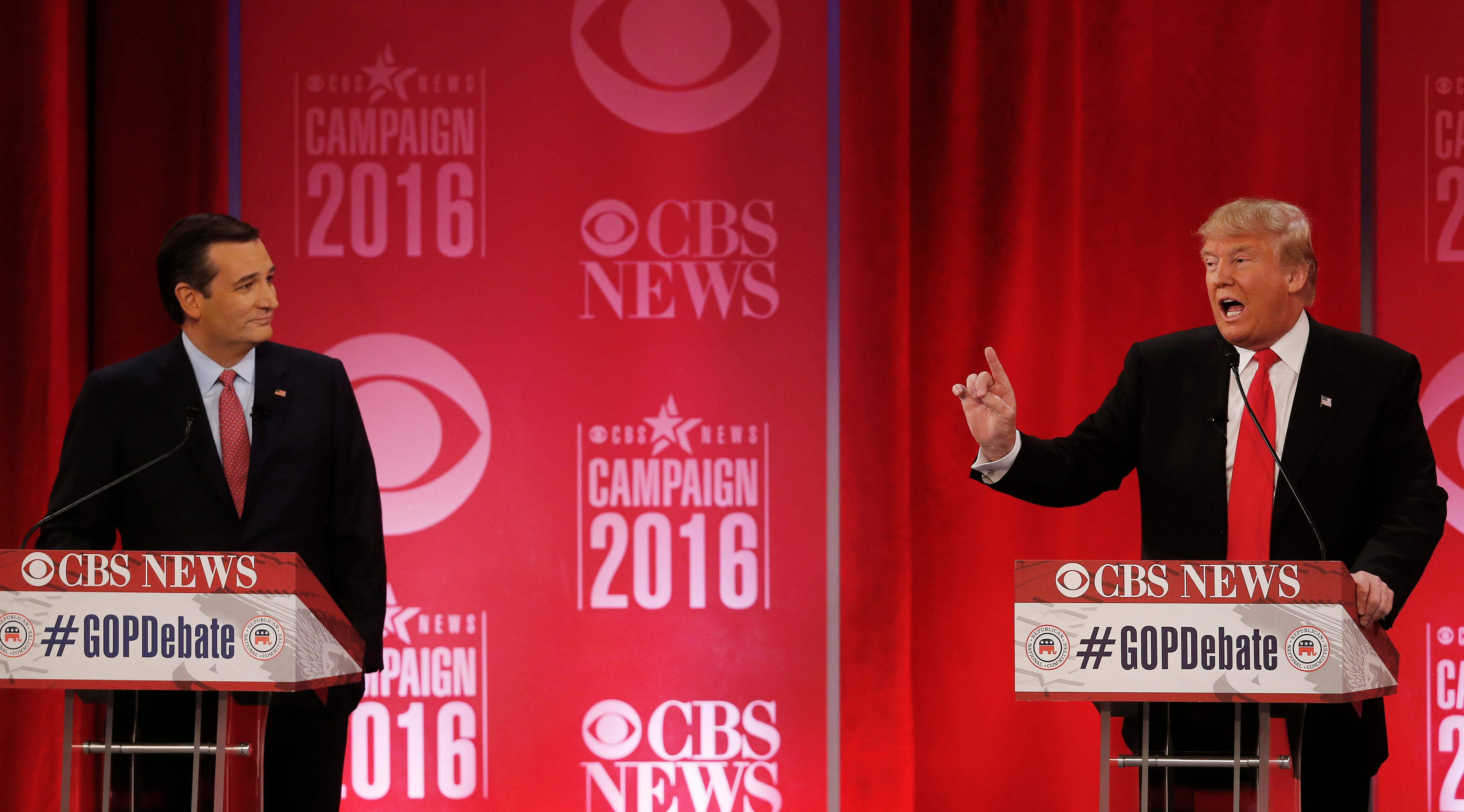 Republican presidential candidate, businessman Donald Trump speaks as Republican presidential candidate, Sen. Ted Cruz, R-Texas, left, listens during the CBS News Republican presidential debate at the Peace Center, Saturday, Feb. 13, 2016, in Greenville, S.C. (AP Photo/John Bazemore)
