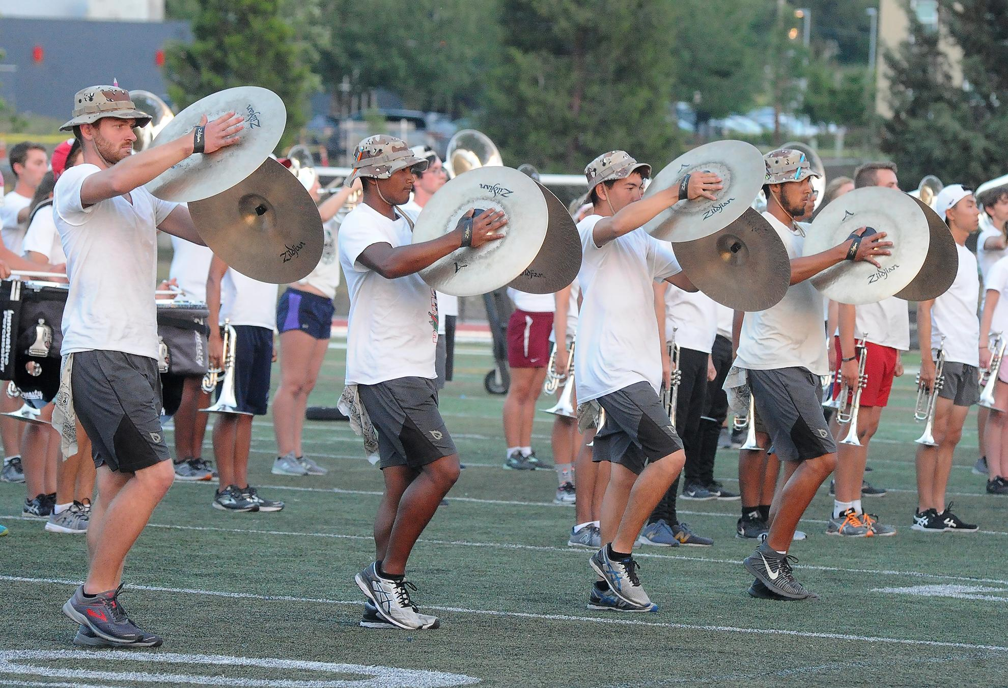 Cymbal players perform as part of the Santa Clara Vanguard Drum and Bugle Corps show. Photo by Denise Baratta