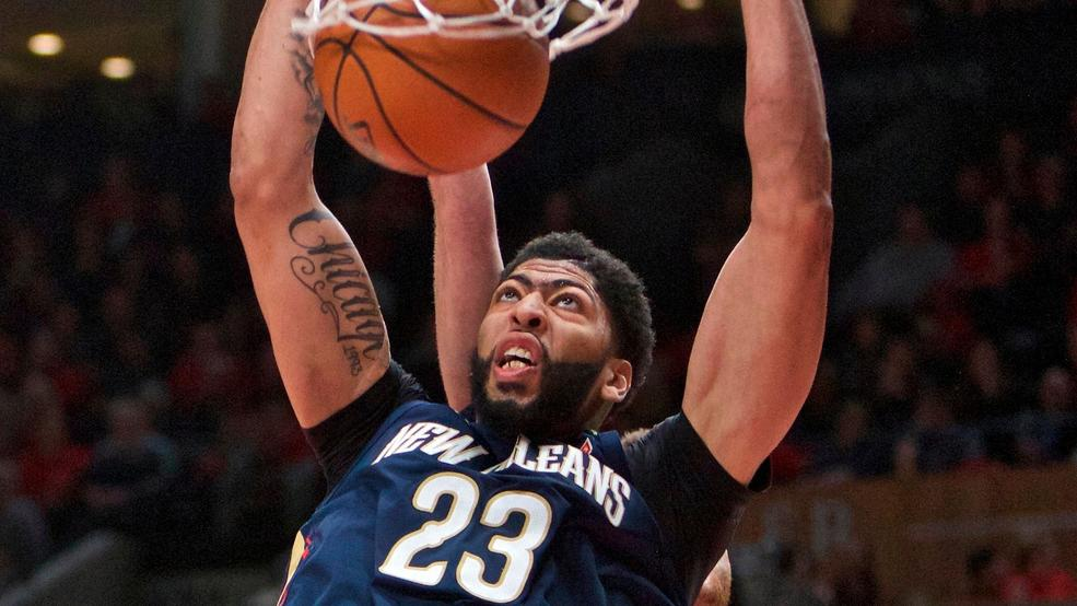 48dd6c8811bd New Orleans Pelicans forward Anthony Davis dunks in front of Portland Trail  Blazers center Jusuf Nurkic during the first half of Game 2 of an NBA  basketball ...