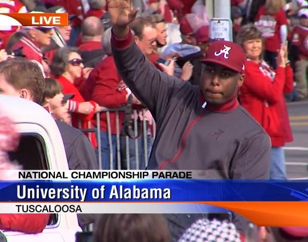 Alabama senior defensive lineman Damion Square waves to the fans during the BCS National Championship parade on Saturday, January 19, 2013.