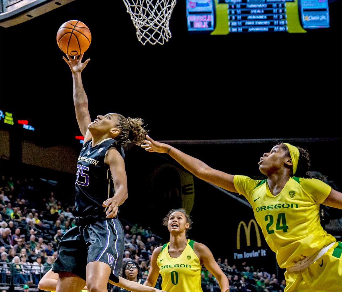 The Huskies' Alexis Griggsby (#35) goes up for the basket. The Oregon Ducks defeated the Washington Huskies 94-83 on Sunday at Matthew Knight Arena. The victory was Head Coach Kelly Graves' 500th career win. Sabrina Ionescu also set the new NCAA all time record of 8 triple doubles in just 48 games. The previous record was 7 triple doubles in 124 games, held by Susie McConnell at Penn State. The Ducks will next face off against USC on Friday January 5th in Los Angeles. Photo by Rhianna Gelhart, Oregon News Lab