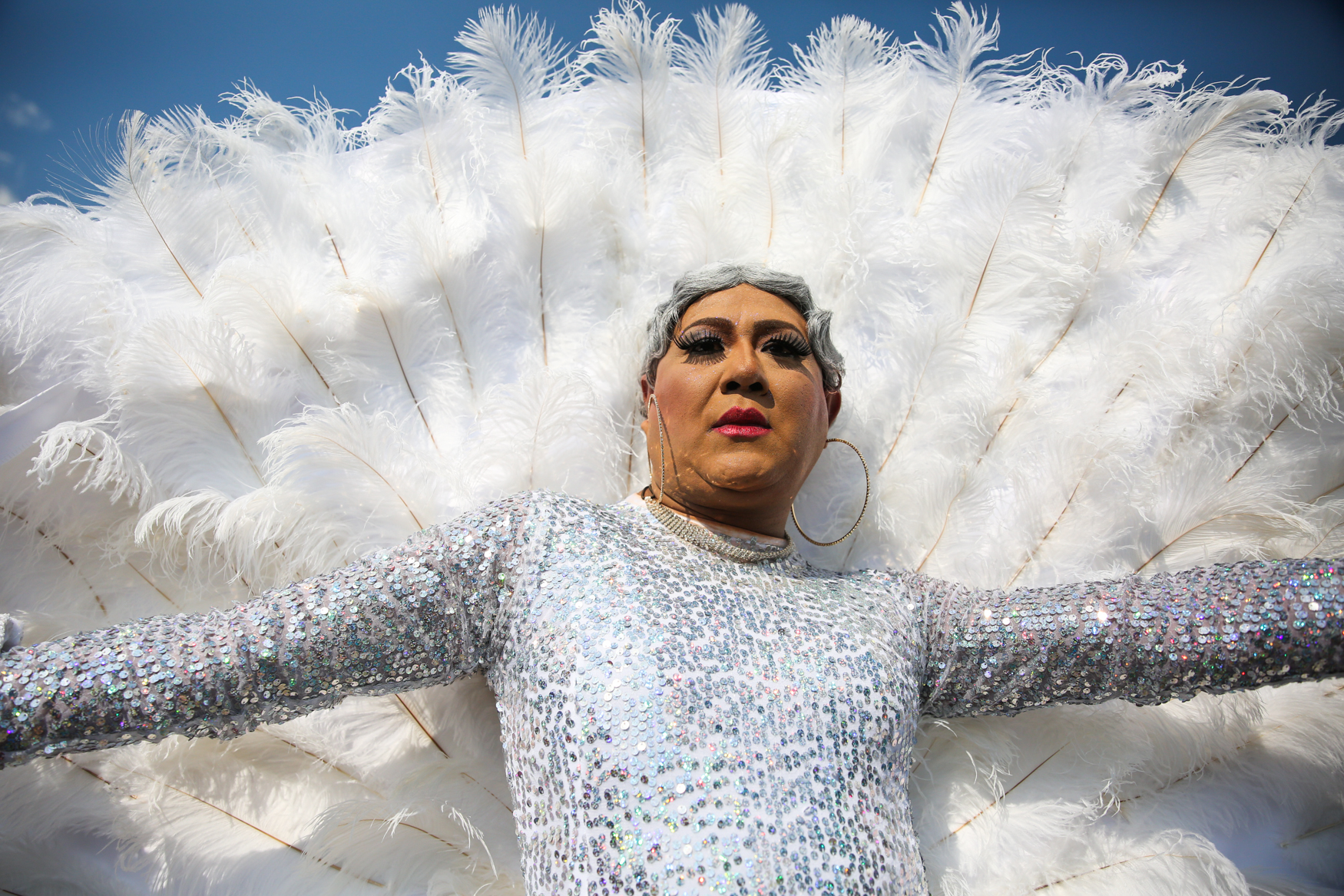 A performer shimmies down the street in Carnival attire during the Washington D.C. pride parade (Amanda Andrade-Rhoades/DC Refined)