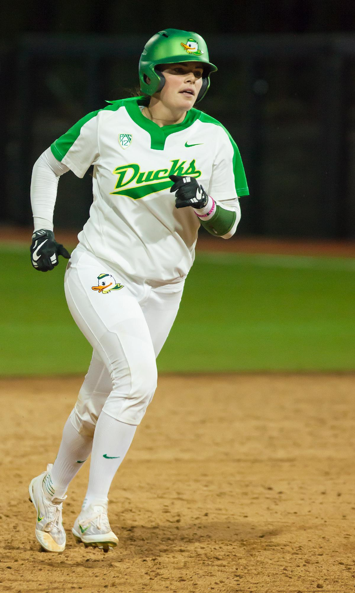 Oregon catcher Gwen Svekis (#21) runs towards third base during her home run. In the first of a three game series the Oregon Ducks defeated the California Golden Bears five to one. Photo by Ben Lonergan, Oregon News Lab