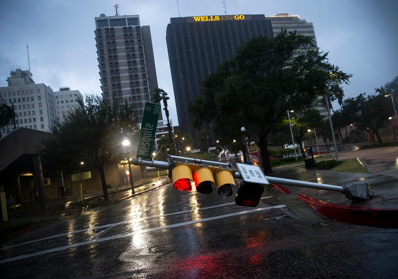 A damaged stop light blocks a street as Hurricane Harvey makes landfall in Corpus Christi, Texas, on Friday, Aug. 25, 2017. Hurricane Harvey smashed into Texas late Friday, lashing a wide swath of the Gulf Coast with strong winds and torrential rain from the fiercest hurricane to hit the U.S. in more than a decade.  (Nick Wagner/Austin American-Statesman via AP)
