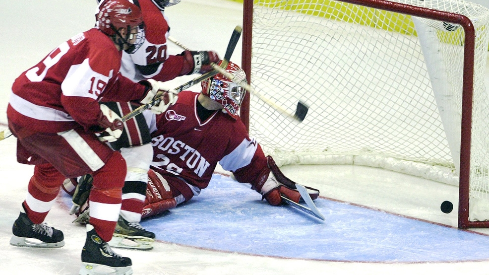 St. Lawrence winger Robin Carruthers scores the winning goal againstBoston University's Rick DiPietro during the fourth overtime of the NCAA East Regional final on March 26, 2000, in Albany, N.Y. The Saints' 3-2 victoryendedthe longest NCAA hockey tournament game ever. (Photo by John Bohn/The Boston Globe via Getty Images)