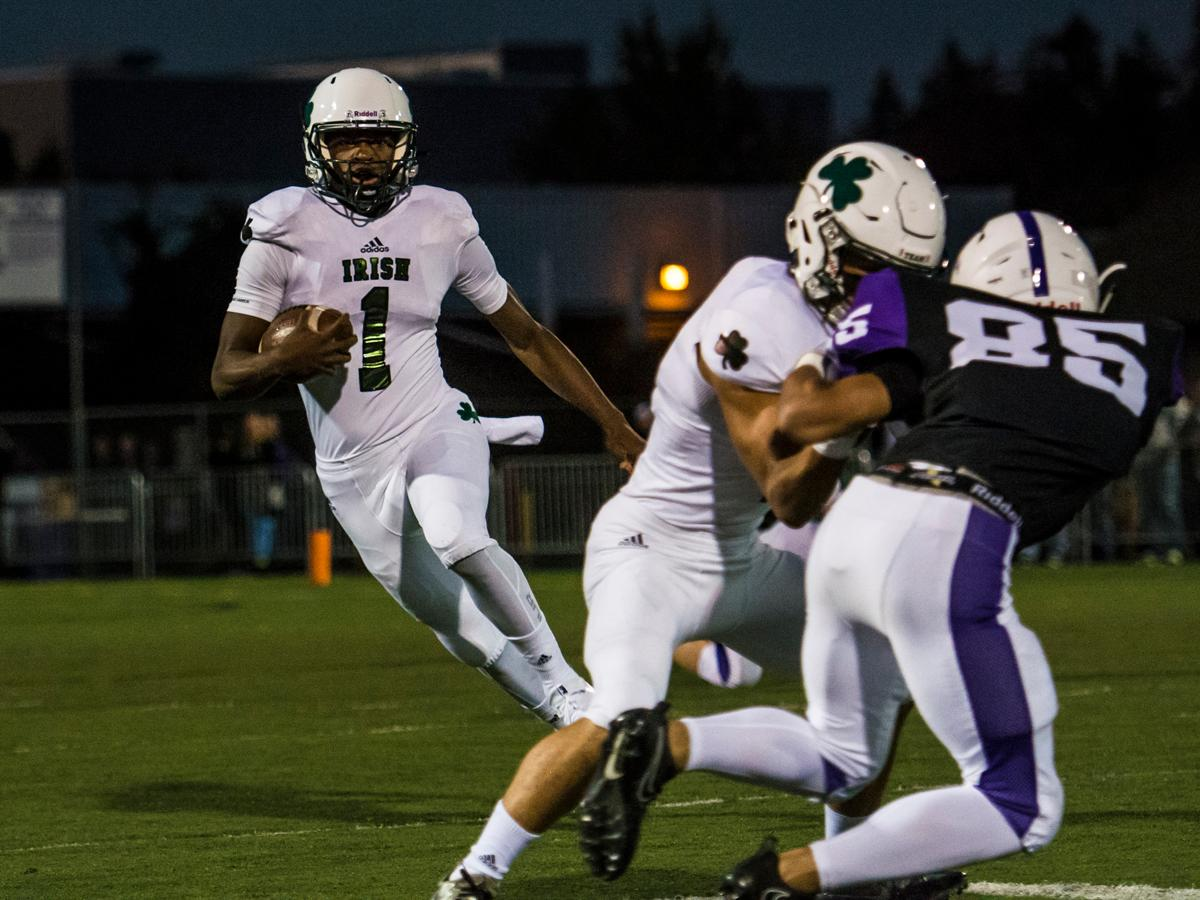 Sheldon Irish quarterback Michael Johnson runs for a touchdown on their opening drive against the South Eugene Axemen at South Eugene high school, October 6, 2017. ( Colin Houck/ For KVAL