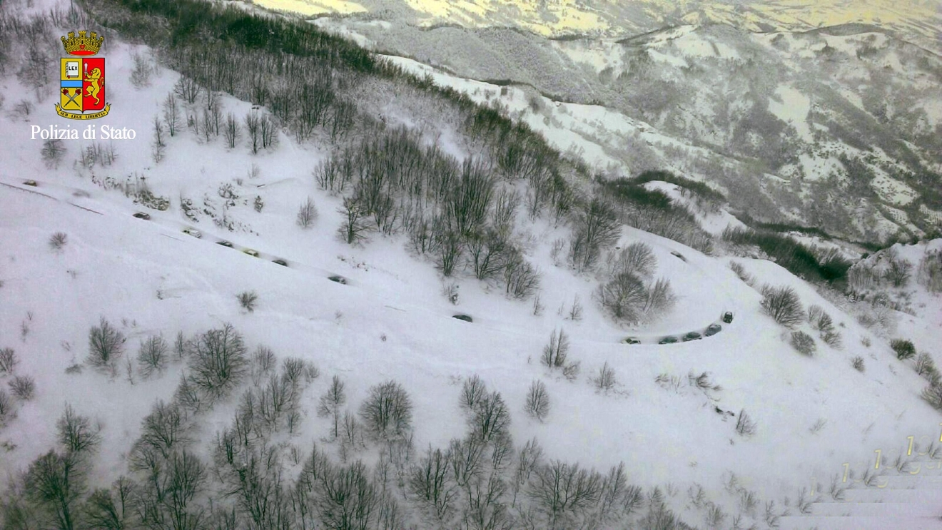 Rigopiano hotel avalanche first funerals as search goes on bbc news - A Line Of Rescue Vehicles Make Their Way To The Hotel Hit By An Avalanche In