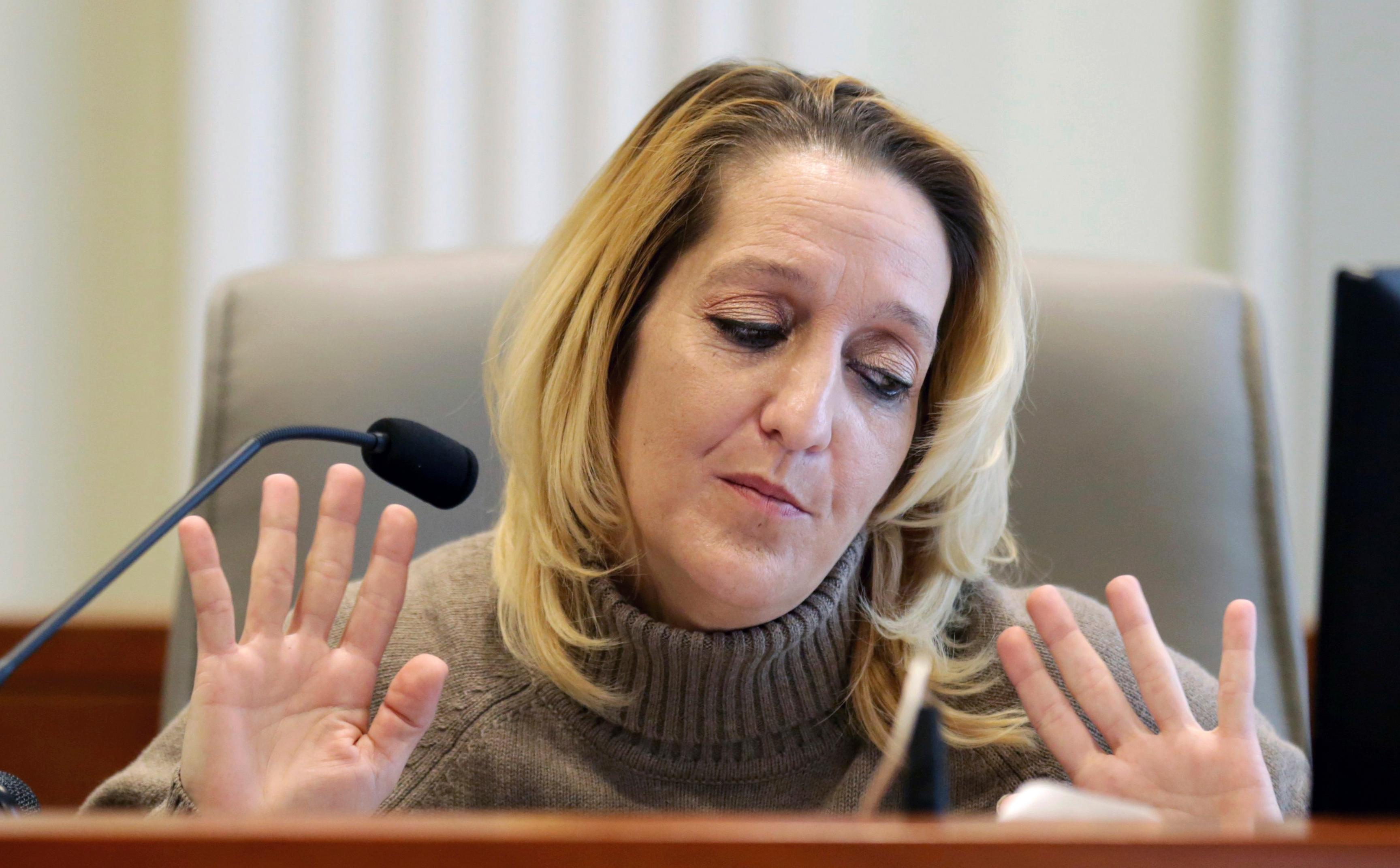 Lisa Britt throws up her hands as she answers a question by by attorney Marc Elias during the public evidentiary hearing on the 9th Congressional District investigation at the North Carolina State Bar Monday, Feb. 18, 2019, in Raleigh, N.C. (Juli Leonard/The News & Observer via AP, Pool)