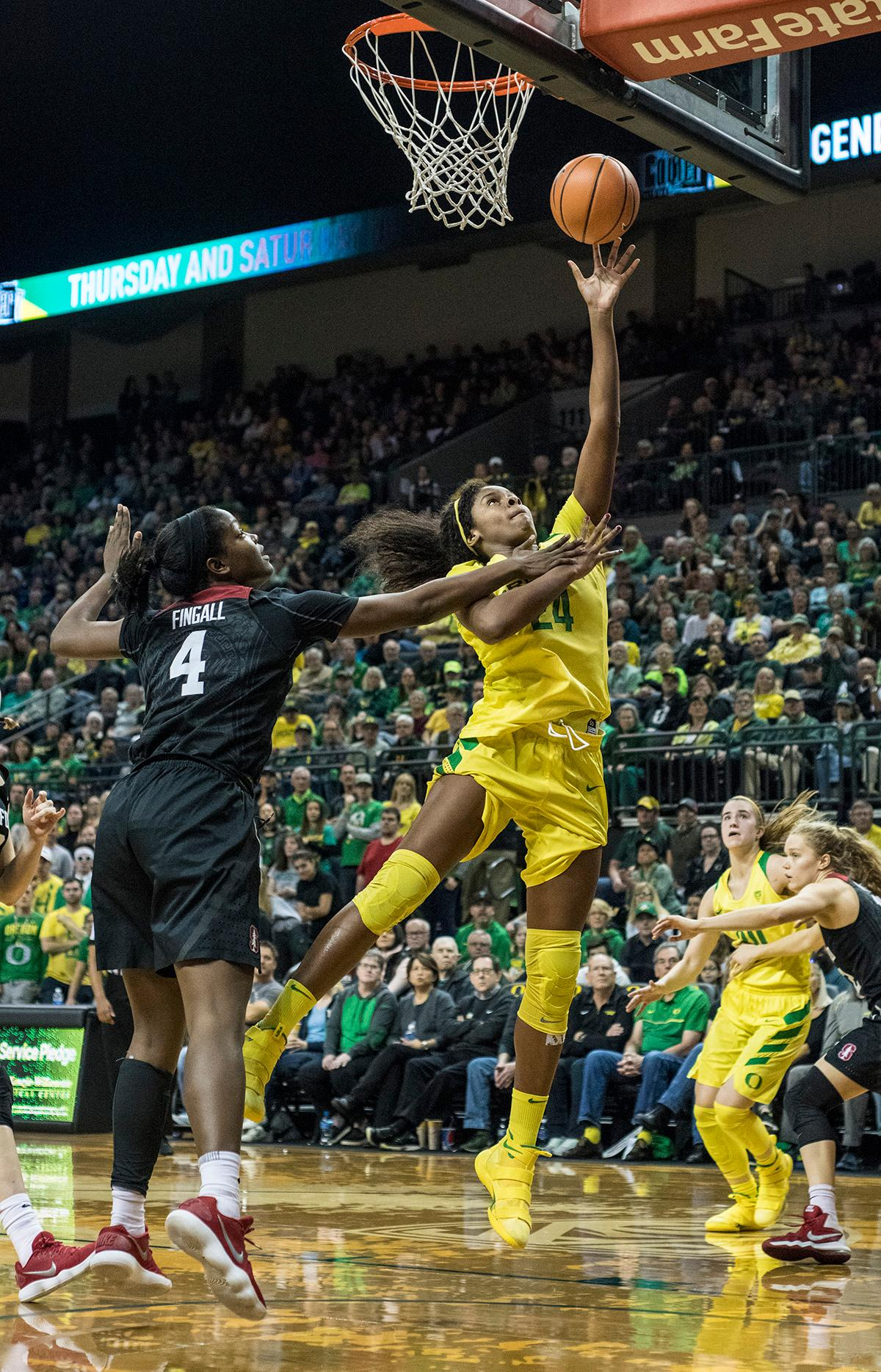 Oregon Ducks Ruthy Hebard (#24) makes a layup. The Stanford Cardinal defeated the Oregon Ducks 78-65 on Sunday afternoon at Matthew Knight Arena. Stanford is now 10-2 in conference play and with this loss the Ducks drop to 10-2. Leading the Stanford Cardinal was Brittany McPhee with 33 points, Alanna Smith with 14 points, and Kiana Williams with 14 points. For the Ducks Sabrina Ionescu led with 22 points, Ruthy Hebard added 16 points, and Satou Sabally put in 14 points. Photo by Rhianna Gelhart, Oregon News Lab