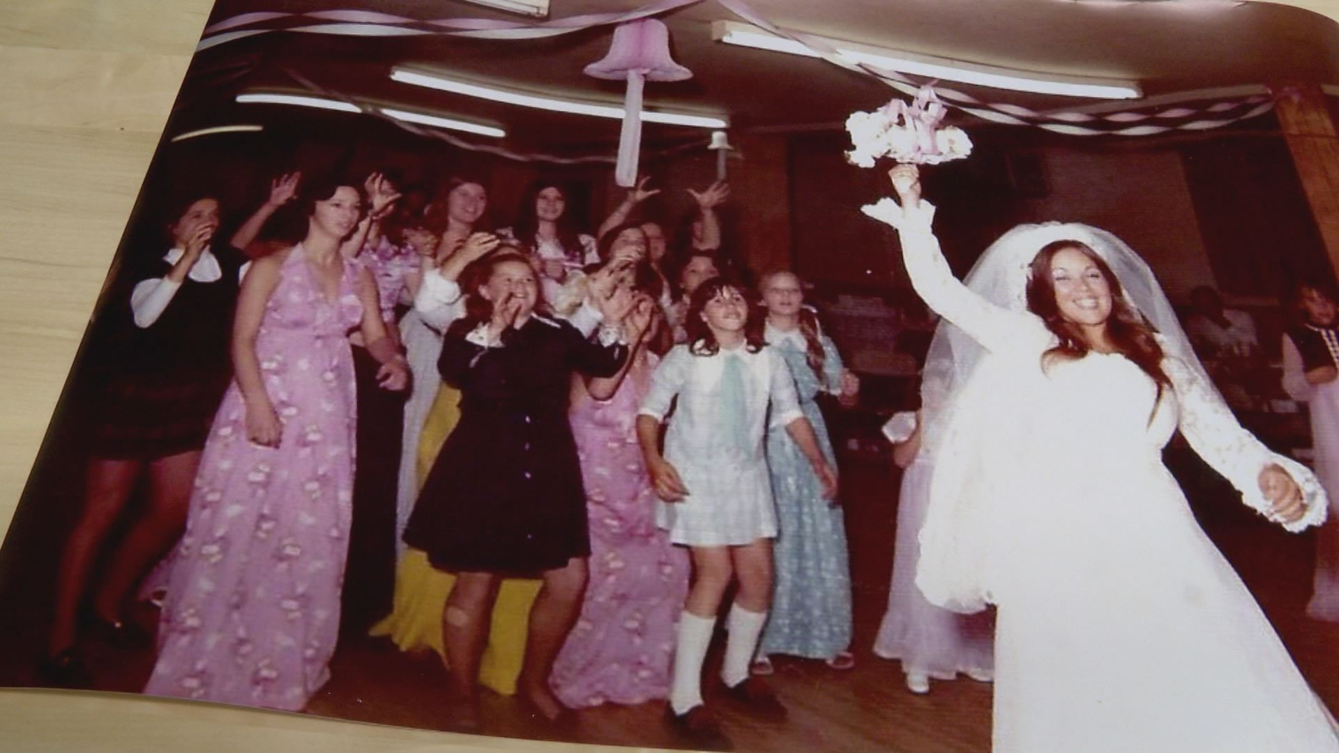 Melanie's mother tossing her bouquet in the old Elks lodge.