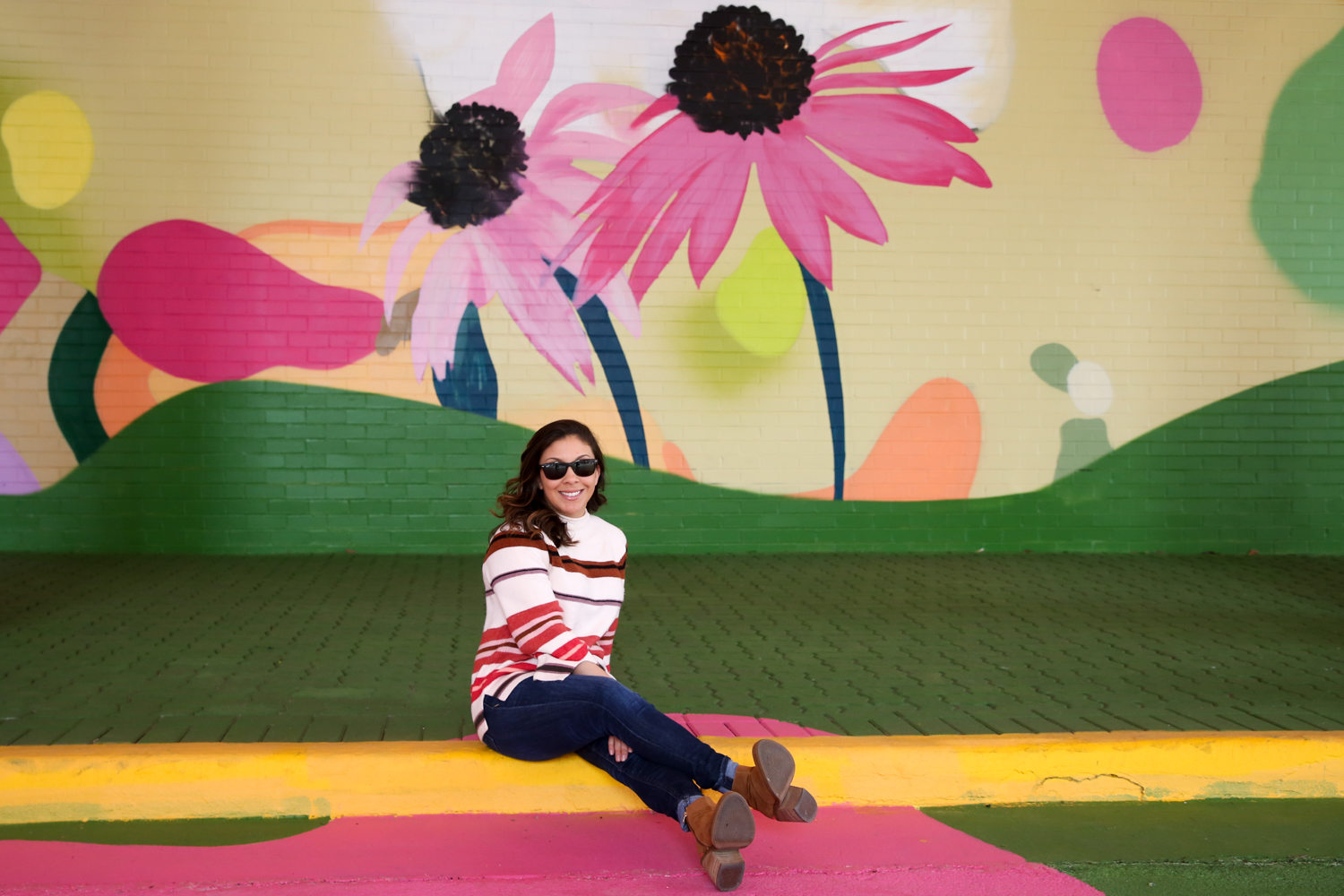 Outside of D.C., the walls of the Crystal Wynwood Mural are currently the hues of spring. The series of murals changes periodically, but right now the word 'lovers' inscribed over millennial pink and framed by flowers. You can find it at{&nbsp;}<br><strong>1851 S Bell St, Arlington, VA.{&nbsp;}</strong>(Amanda Andrade-Rhoades/DC Refined)