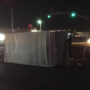 Truck turns on its side following overnight crash