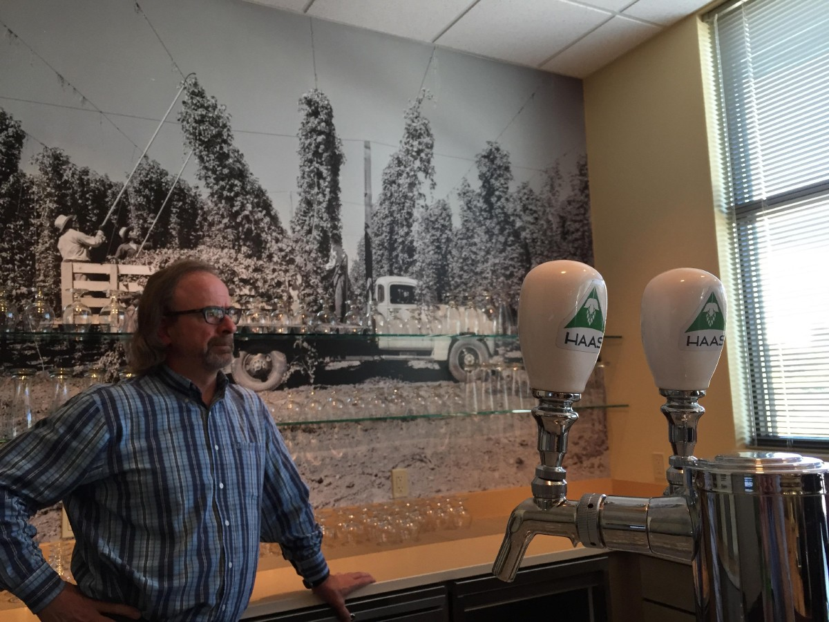 Tim Kostelecky of the Haas Innovation Brewery with some of the taps of their test brews. (Image: Frank Guanco)