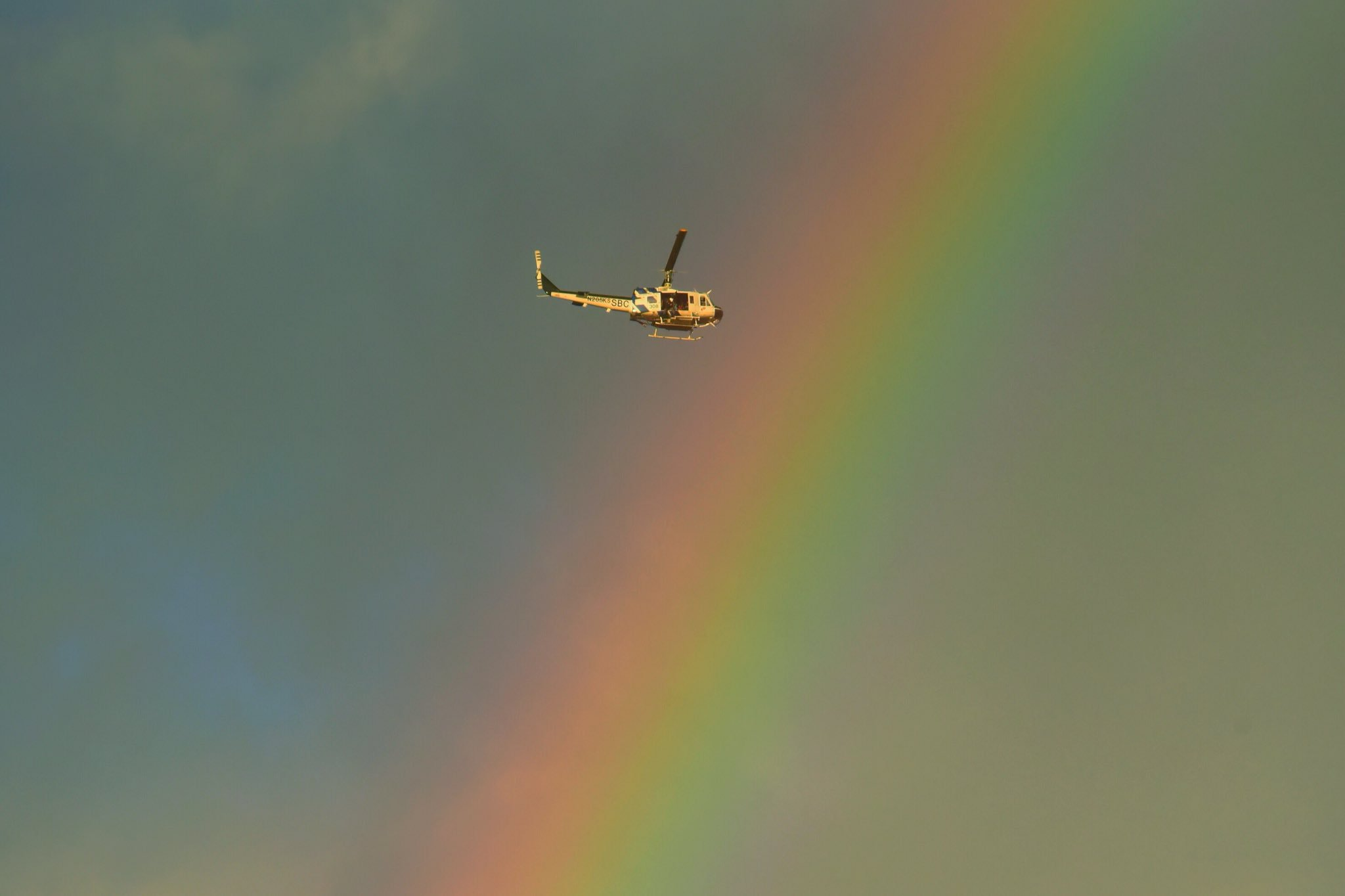 { }Santa Barbara County Air Support Unit's Fire Copter 308 flies through a rainbow Tuesday afternoon while on a rescue mission in Montecito following deadly mudflow after heavy rains trapped dozens of people.{ }(Photo & Caption: Mike Eliason, Santa Barbara County Fire Dept.)