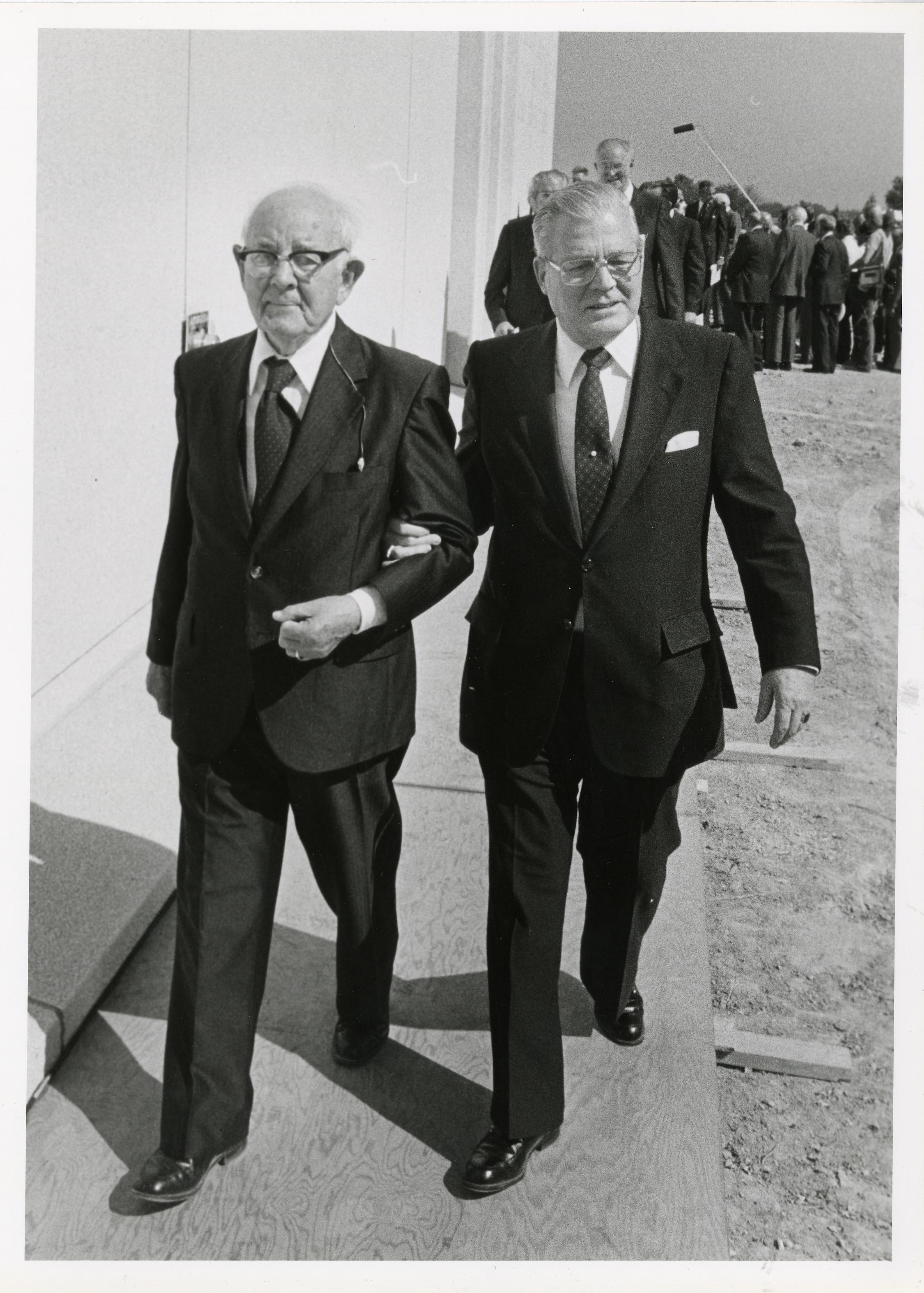 Spencer W. Kimball, president of the Church is being escorted by his secretary D. Arthur Haycock for the dedication of the Jordan River Utah Temple in 1981. ©ALL RIGHTS RESERVED.