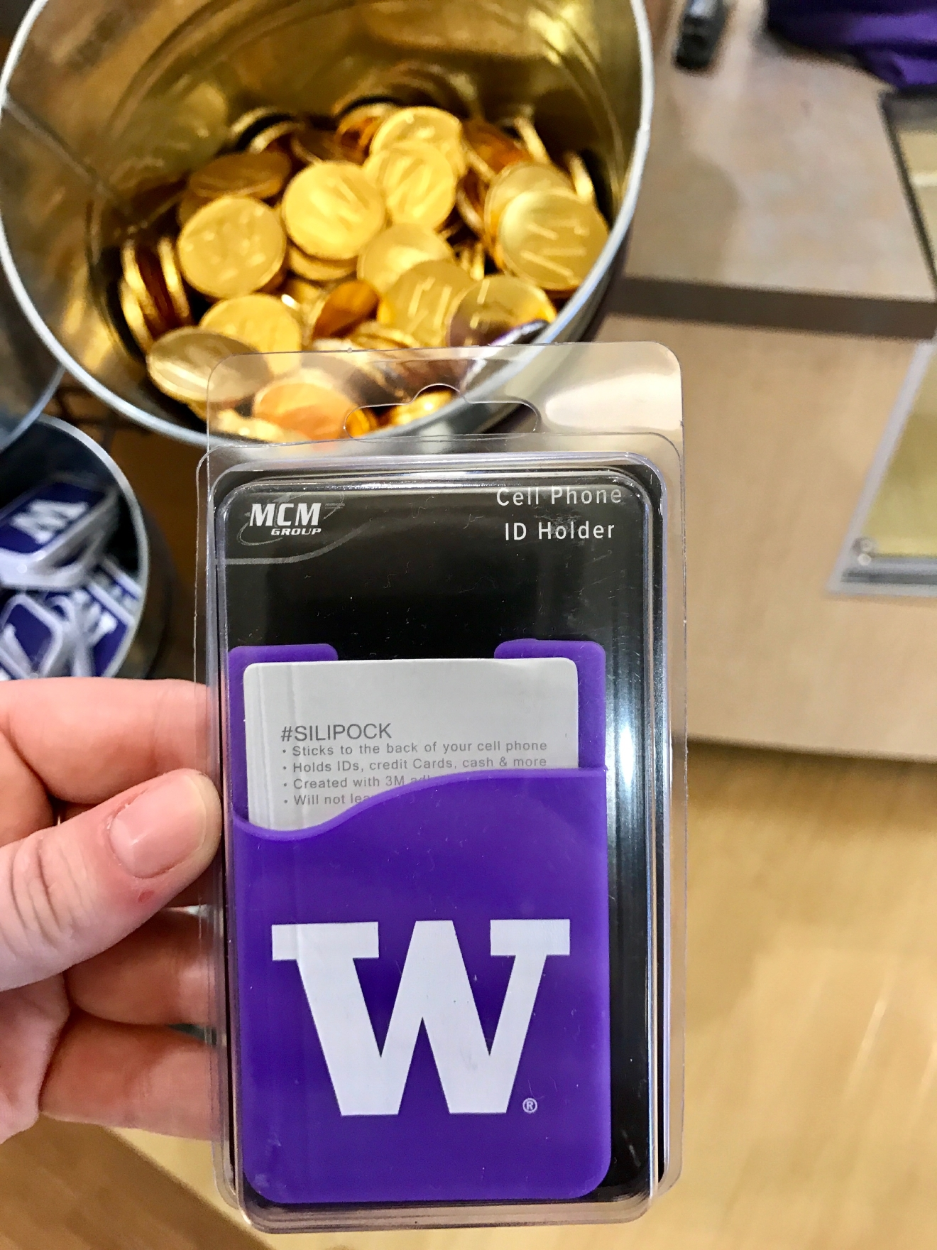 UW Credit Card Phone Case - $3.95                                          Whether you're a current student, alum, or just *love* the Dawgs, it's a pretty exciting time to be a Husky fan right now. Just to catch you up, the University of Washington football team is having one of their best seasons in years, and will be playing the Peach Bowl in Atlanta on December 31st. If you know a Dawg fan, they're probably salivating at the mouth right about now. Which is why it's a perfect time to give them a themed gift! Here are some of the coolest Husky gear we saw at the University Bookstore on the Avenue during our last visit. Pro Tip: They're open 10 a.m. - 7 p.m. on Christmas Eve! (Image: Britt Thorson / Seattle Refined)