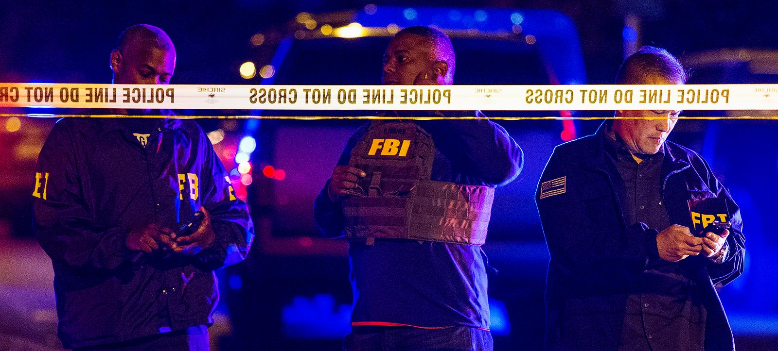 FBI agents work the scene of an explosion in Austin, Texas, Sunday, March 18, 2018. At least a few people were injured in another explosion in Texas' capital late Sunday, after three package bombs detonated this month in other parts of the city, killing two people and injuring two others. (Nick Wagner/Austin American-Statesman via AP)