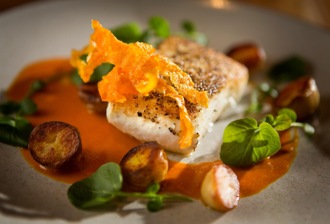 For one of the entrees, Chef Joe Ritchie will be serving Seared Halibut, with lemon-carrot puree, new potatoes, and wild watercress, during Seattle Restaurant Week at Goldfinch Tavern at the Four Seasons Hotel. Other entrees include Grilled Beef Hanger Steak and Stinging Nettle Pasta. (Sy Bean / Seattle Refined)