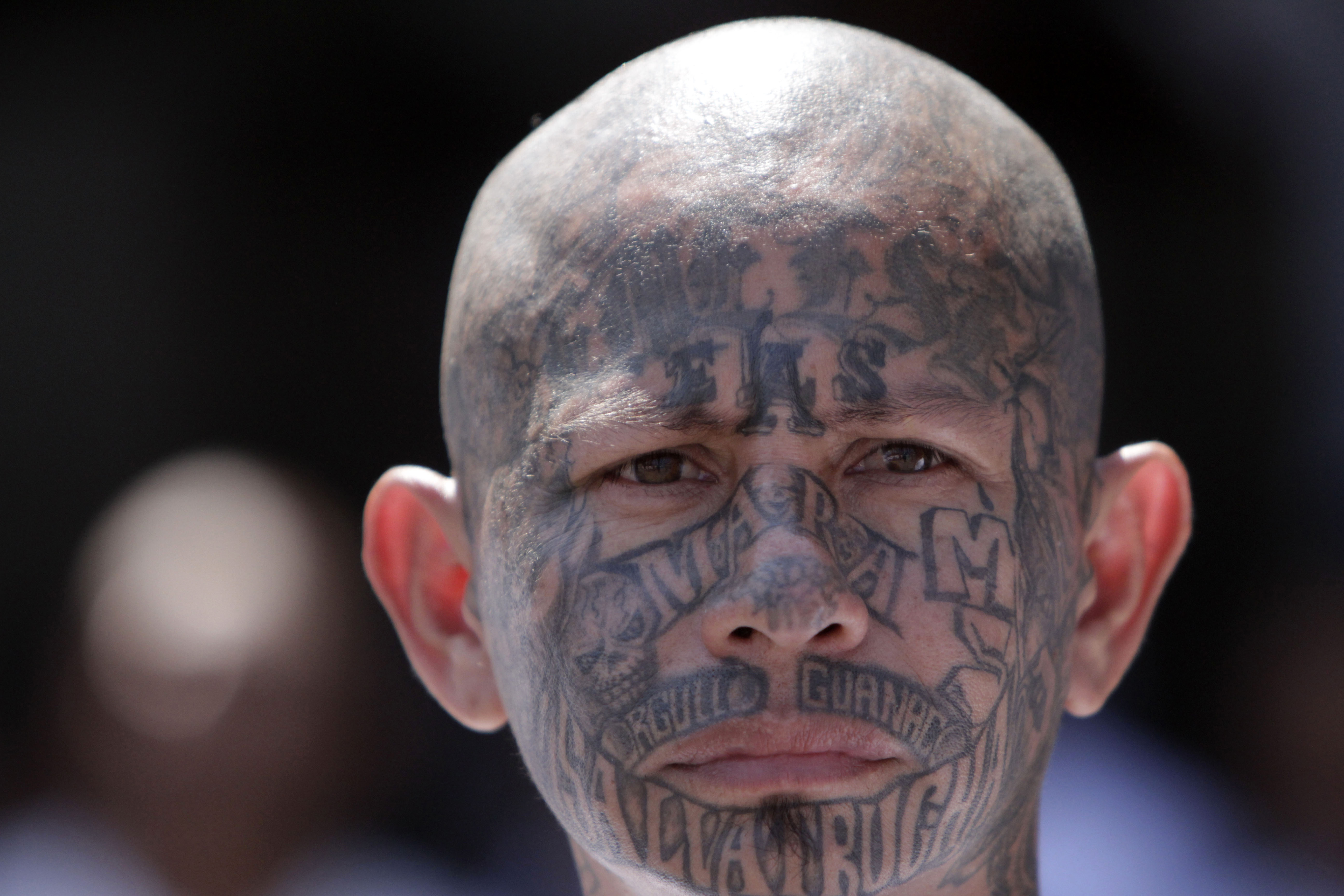 In this March 26, 2012 photo, an inmate belonging to the Mara Salvatrucha or MS-13 gang stands inside the prison in Ciudad Barrios, El Salvador.  Six months after El Salvador brokered an historic truce between two rival gangs to curb the nation's daunting homicide rate, officials are split over whether the truce actually works. The gangs, which also operate in Guatemala and Honduras, are seeking truce talks in those countries as well. (AP Photo/Luis Romero)
