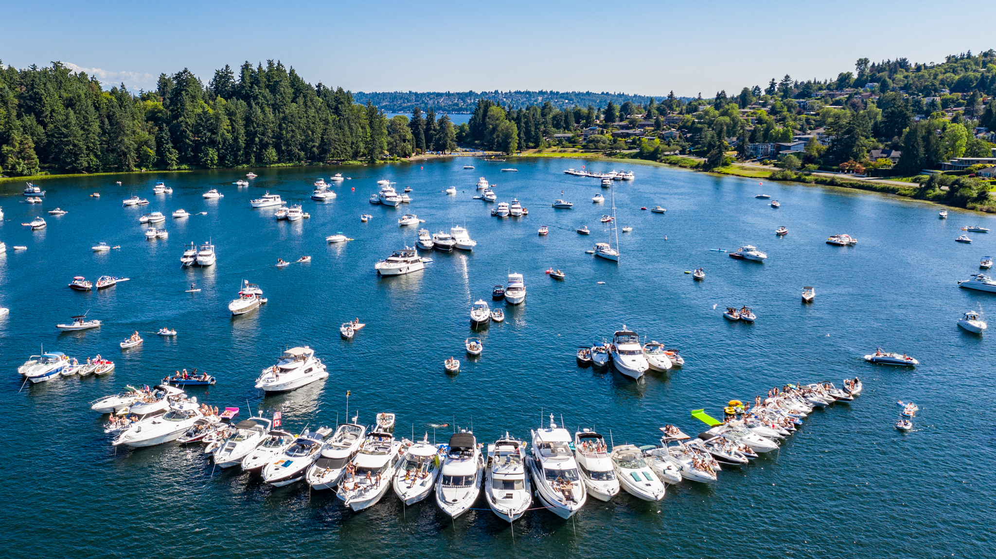 "It's Seafair Weekend 2020 (minus the fair and Blue Angels), so we thought we'd bring you some photos to remind you of the Seafairs of years past and present! Temperatures are high, and the lake is open - what is your favorite way to social distance while enjoying the water? From water sports to taking in views of Mt. Rainier to the Ballard Locks to Duck Dodge - the options are endless and, if following guidelines, safe. Enjoy Lake Washington during the hottest month of summer! Note: All photos, including people, are from 2018/2019; aerial shots are from 2020. (Image:{&nbsp;}<a  href=""https://andrewjacobmedia.com/"" target=""_blank"" title=""https://andrewjacobmedia.com/"">Andrew Meade</a>{&nbsp;}/ Seattle Refined)"