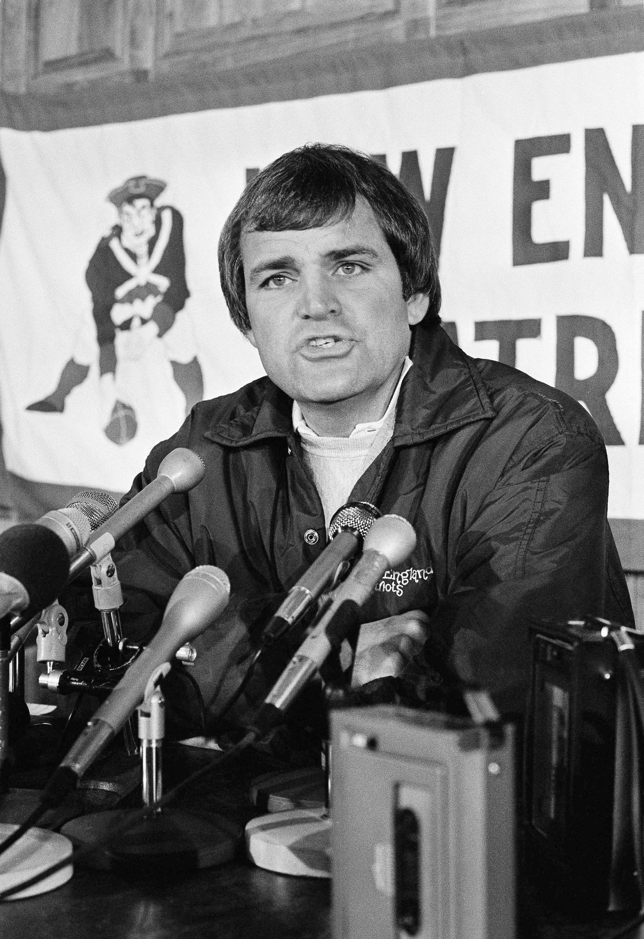"FILE - In this Nov. 17, 1982, file photo, New England Patriots coach Ron Meyer talks with the media in Foxborough, Mass. From SMU's ""Pony Express"" to the NFL's infamous ""Snowplow Game,"" former college and professional football coach Ron Meyer was in the middle of some of the game's most controversial and colorful teams and moments in the 1980s. Meyer died Tuesday, Dec. 5, 2017, in Austin, Texas, at age 76.  (AP Photo/Paul Benoit, File)"